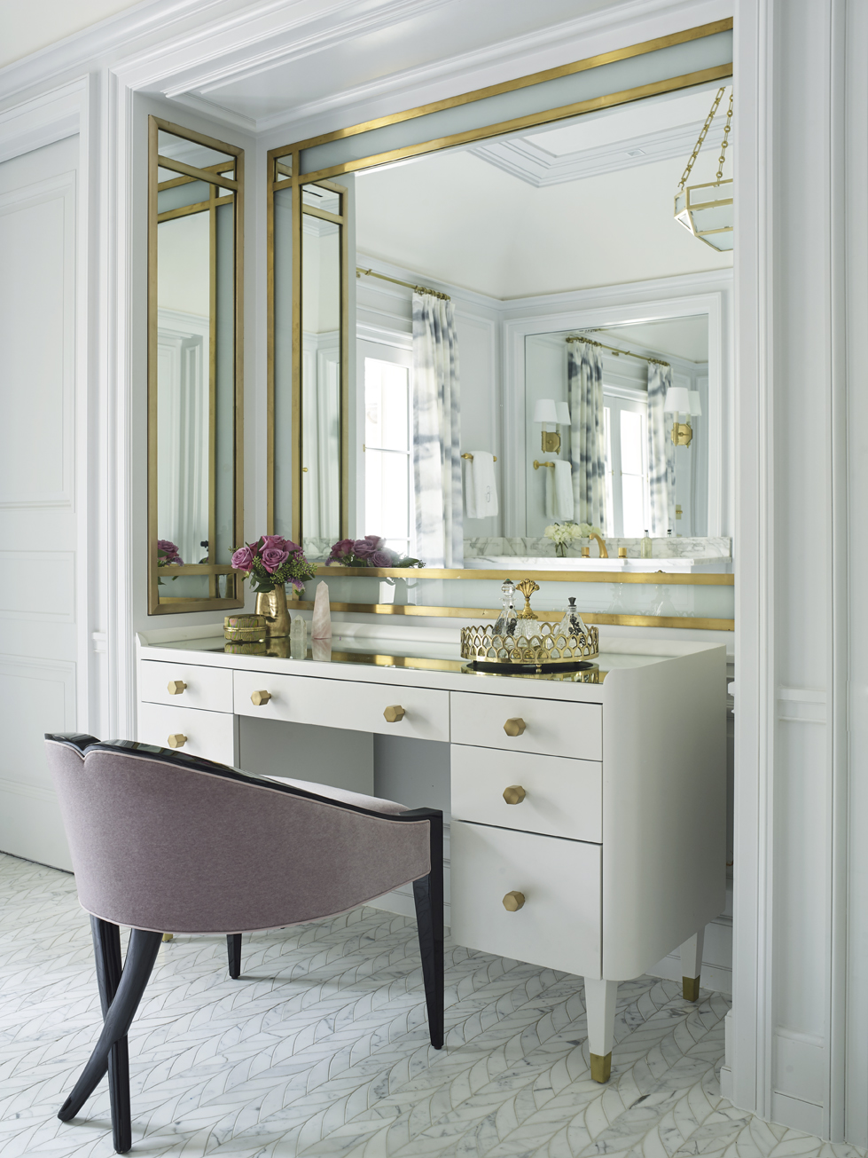 The master bath features a sophisticated vanity set within an alcove.