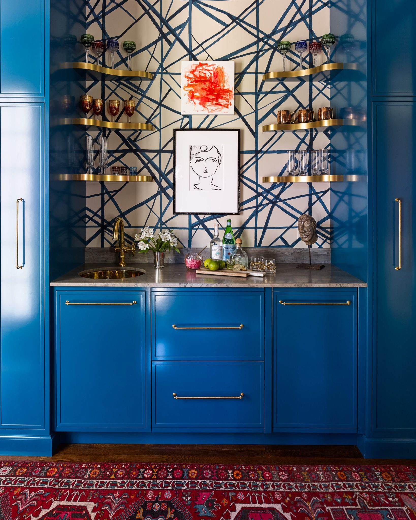 """Merge Style with Function. """"A well-designed bar should have the necessary shelving, storage, and drinkware to be practical, but these things should be worked into the design in a strategic way,"""" saysCharlotte Lucas. """"It's about masking the functionality with color and pretty details.""""   Utilize vertical space. """"Most home bars are in small spaces, so it's crucial to get creative with storage solutions and displays,"""" Lucas says.   Tucked away in a hallway, this bar boastsa bold color to ensurethat it stands out among the surrounding spaces."""