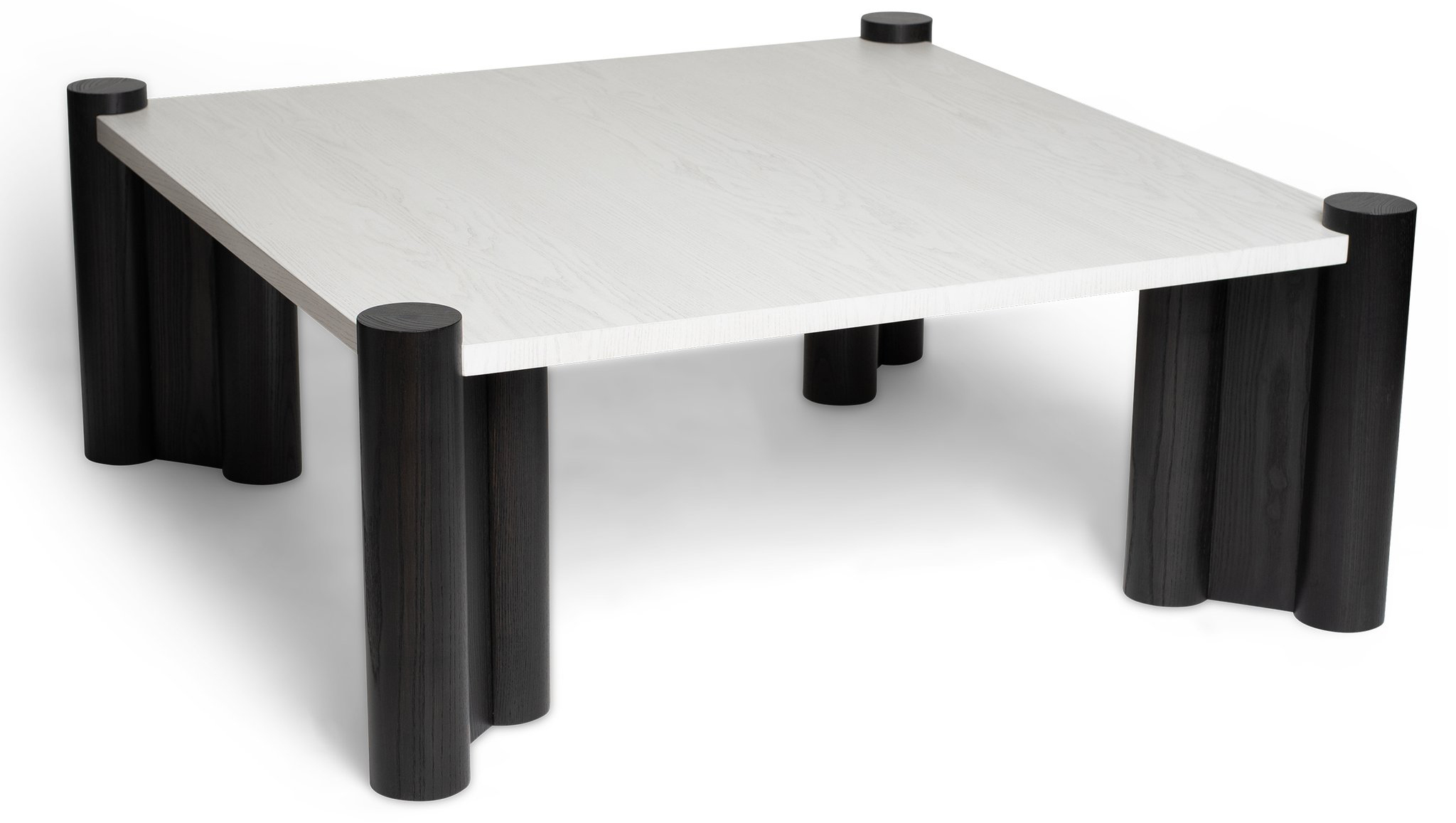 Samson Coffee Table with Pilaster Legs. Shown in Whistler White on Ash (top finish) and Ebony on Ash (base finish). Top finish can be customized with anyBRADLEYconcrete,ColorGlass, antiqued mirror, resine, or wood finish. Base finish can be customized with any BRADLEY wood finish. Lead time: 8-10 weeks.