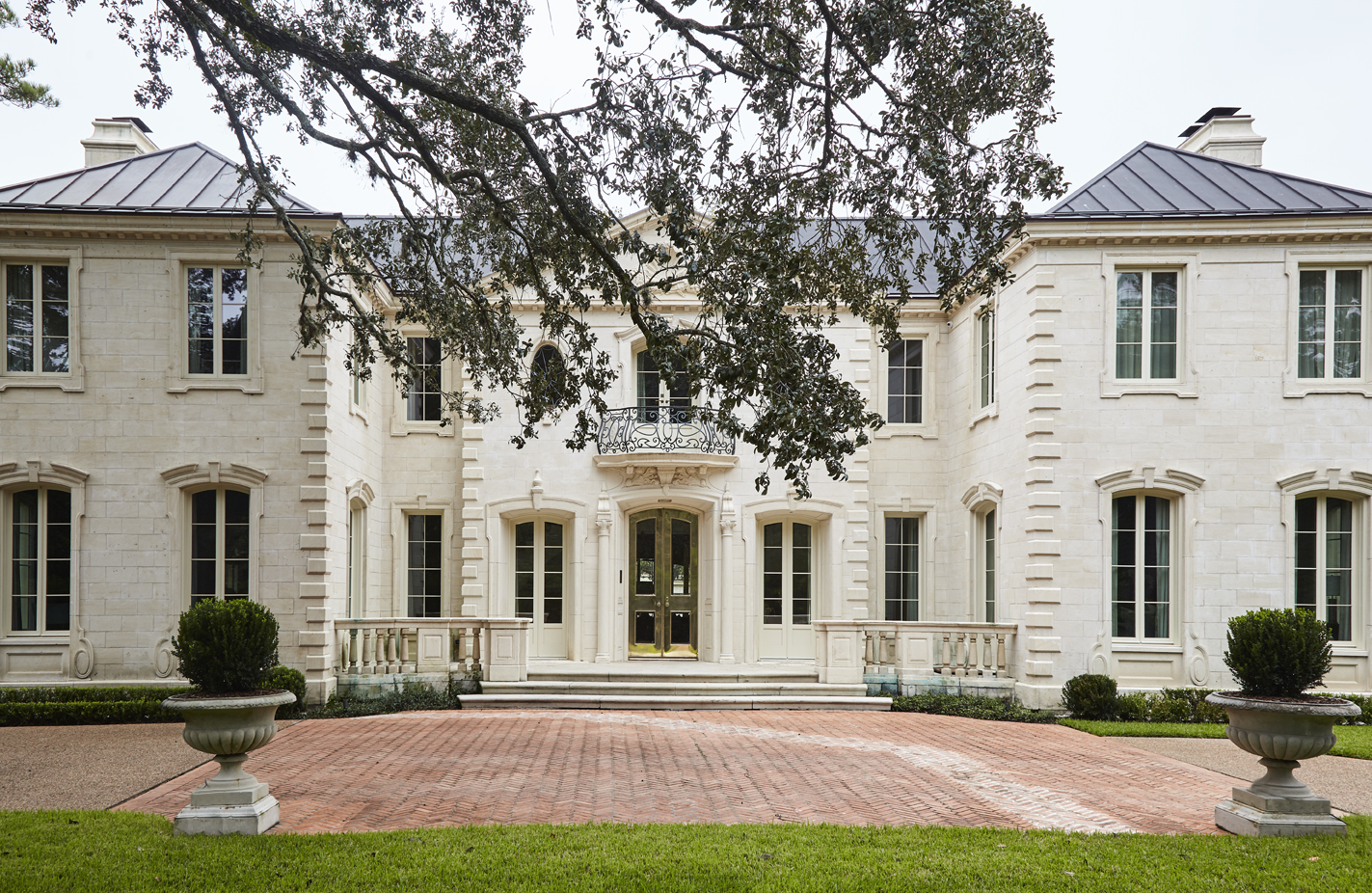Built in 1965, the exterior of the home was modeled after the Baroque pavilions outside Paris, like the Grand Trianon, King Louis XIV's Versailles retreat that was intended to house the king and his mistress. Because the garage of the original property had been impractically positioned and was seldom used, it wasremodeled to serve as a morning room and mudroom on the first floor, and a master bath and dressing area on the second floor.