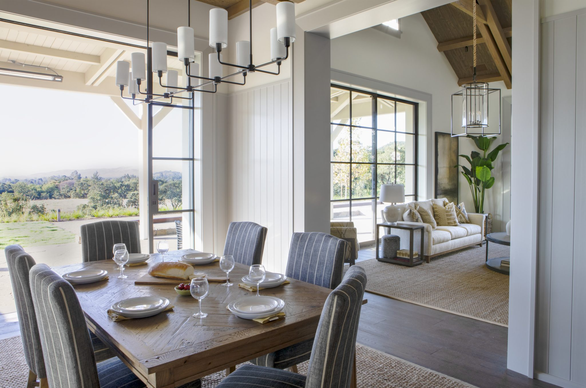 The living, kitchen, and dining areas of the main house all open up to the porches outside.