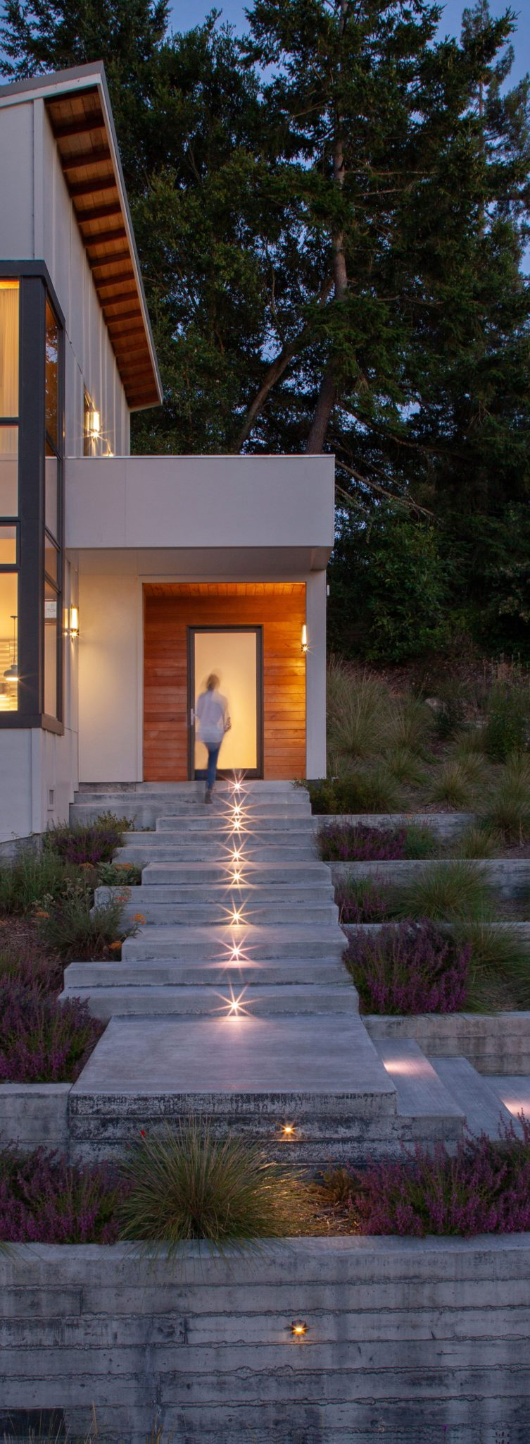 The exterior lighting is by Modern Forms, while the lighting inside the home is by Tech Lighting.