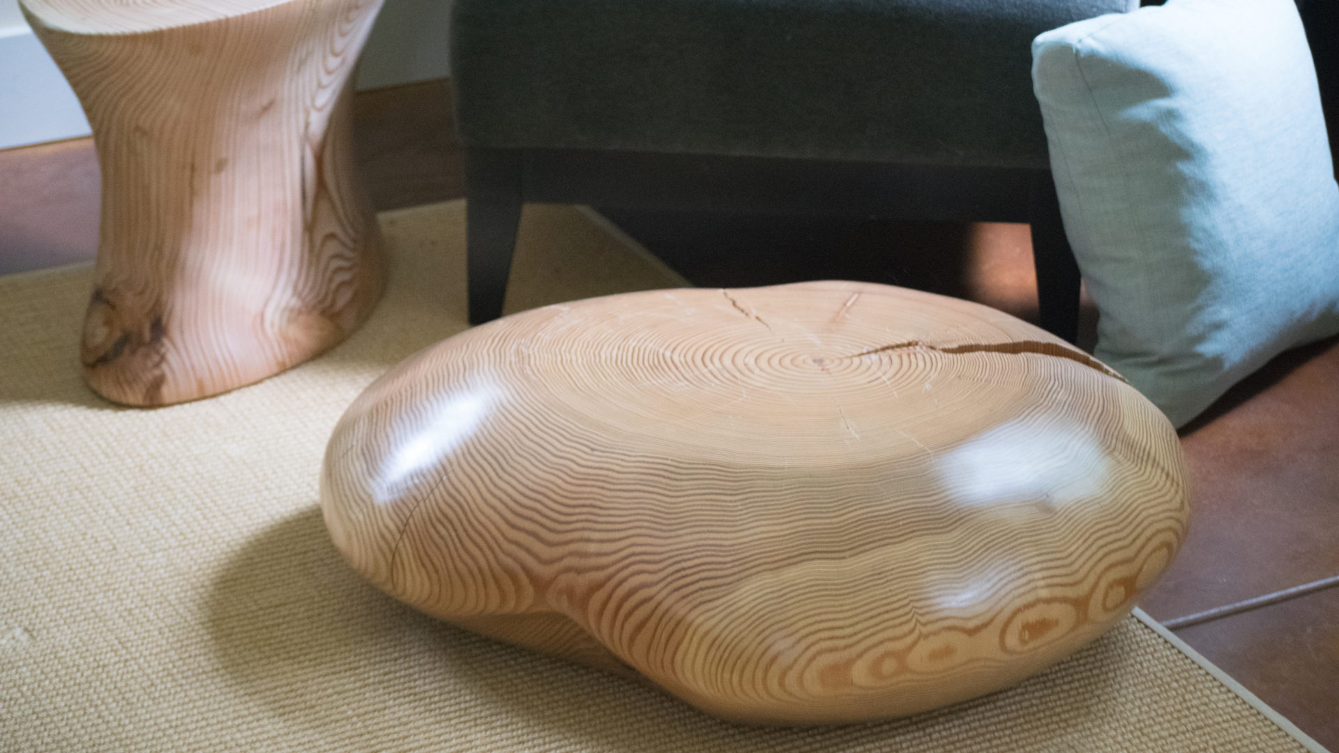 Wood sculptor Joel Sayre left the world of fine furniture making to develop one-of-a-kind tables, stools, bowls, and more.