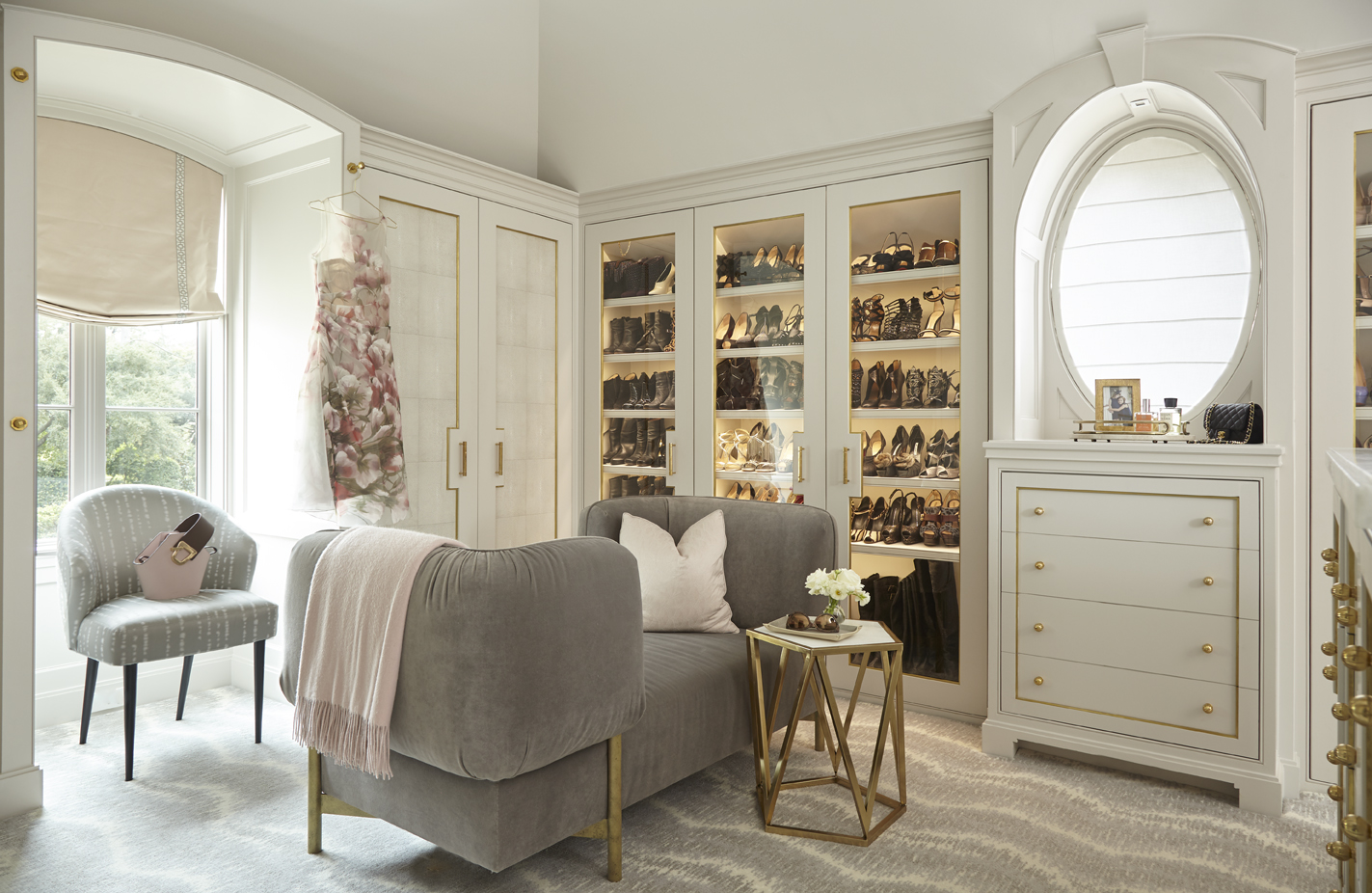 A range of cream-colored, built-in storage options line the walls of the dressing room.