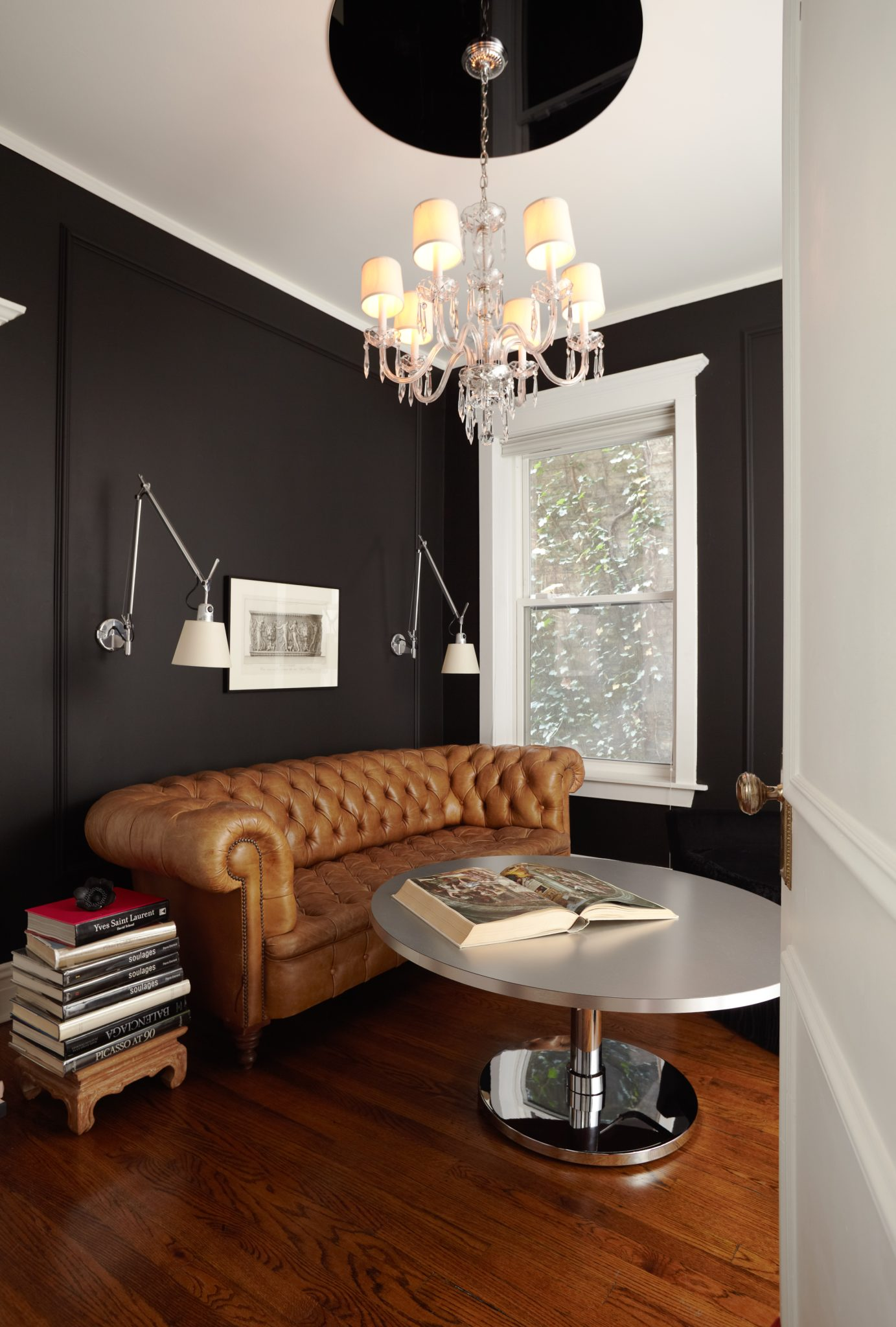 The onyx black den is a reference to French fumeurs, or smoking rooms, and features Donald Sultan prints of smoke rings.