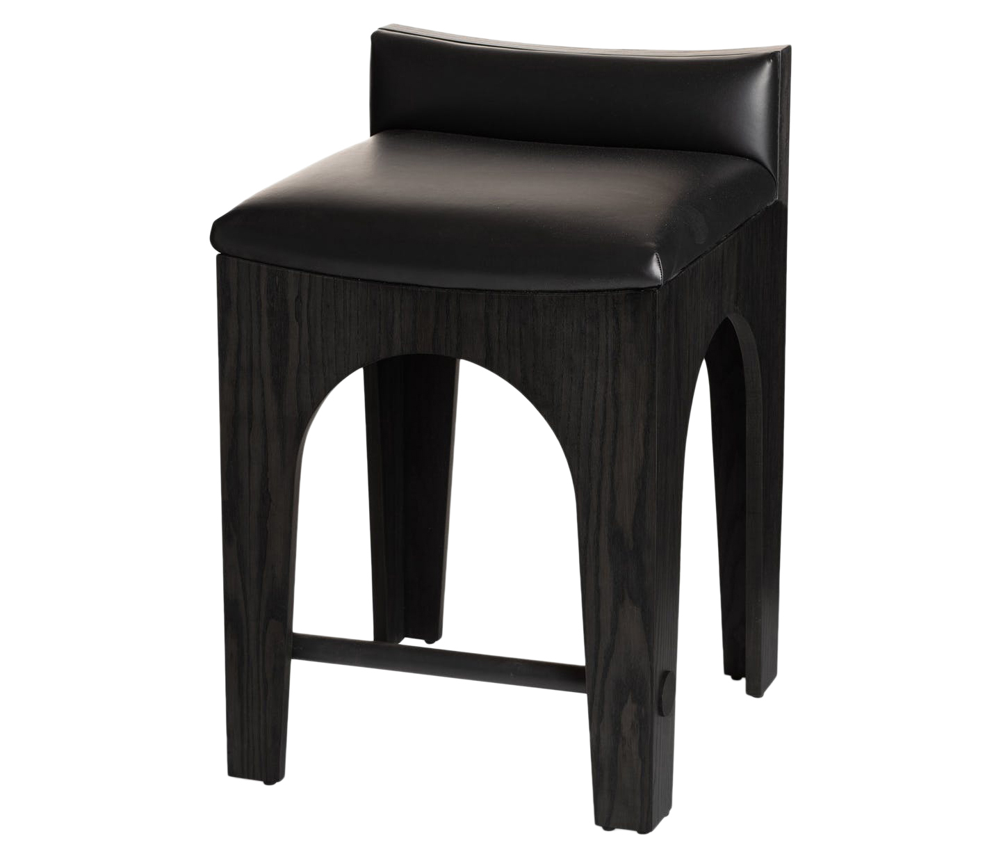 Brandon Arched Counter Stool. Available indining height, counter height, and bar height. Shown inBRADLEYElements Black Forever Leather, Ebony on Ash base, and Satin Black powder-coated stretcher. Available in COM/COL (1 yd solid / 25 sf). Customize with any BRADLEY wood finish for the stool and any BRADLEY iron finish for the stretcher. Lead time:8-10 weeks.