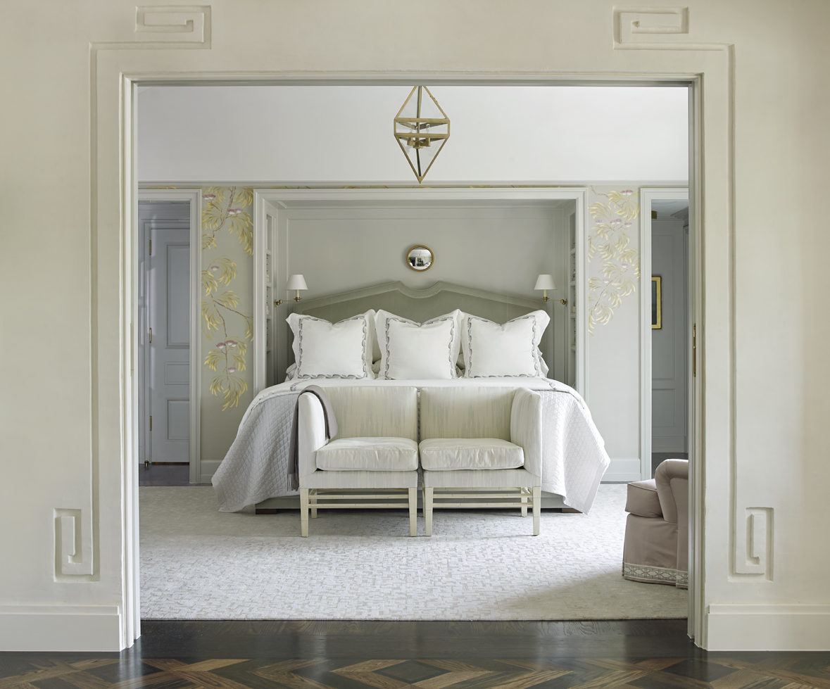 A cased opening bordered by Greek Key detail opens into the master bedroom.