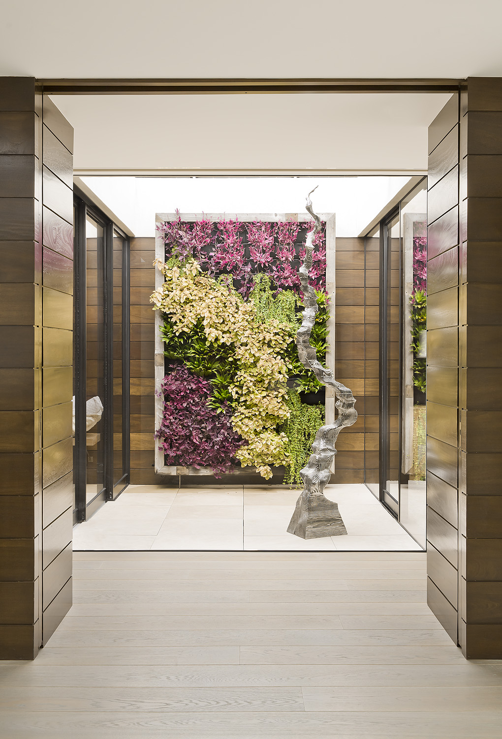 "All About Plant-Life   Bars and restaurants often boast beautiful displays of greenery or flowers, whether it's with a living wall or faux greenery along the ceiling. In this Miami Beach residence, a living wall brings life into a residential entryway. ""Instagrammable spaces often need texture, and green walls serve as the perfect background,"" says May Sung, founder of SUBU Design Architecture.  Created using the Japanese concept of Tsuboniwa (or a small, enclosed garden), ""the green wall creates a connection with the outdoors. It sets a background and frames the composition for the space,"" says Sung."