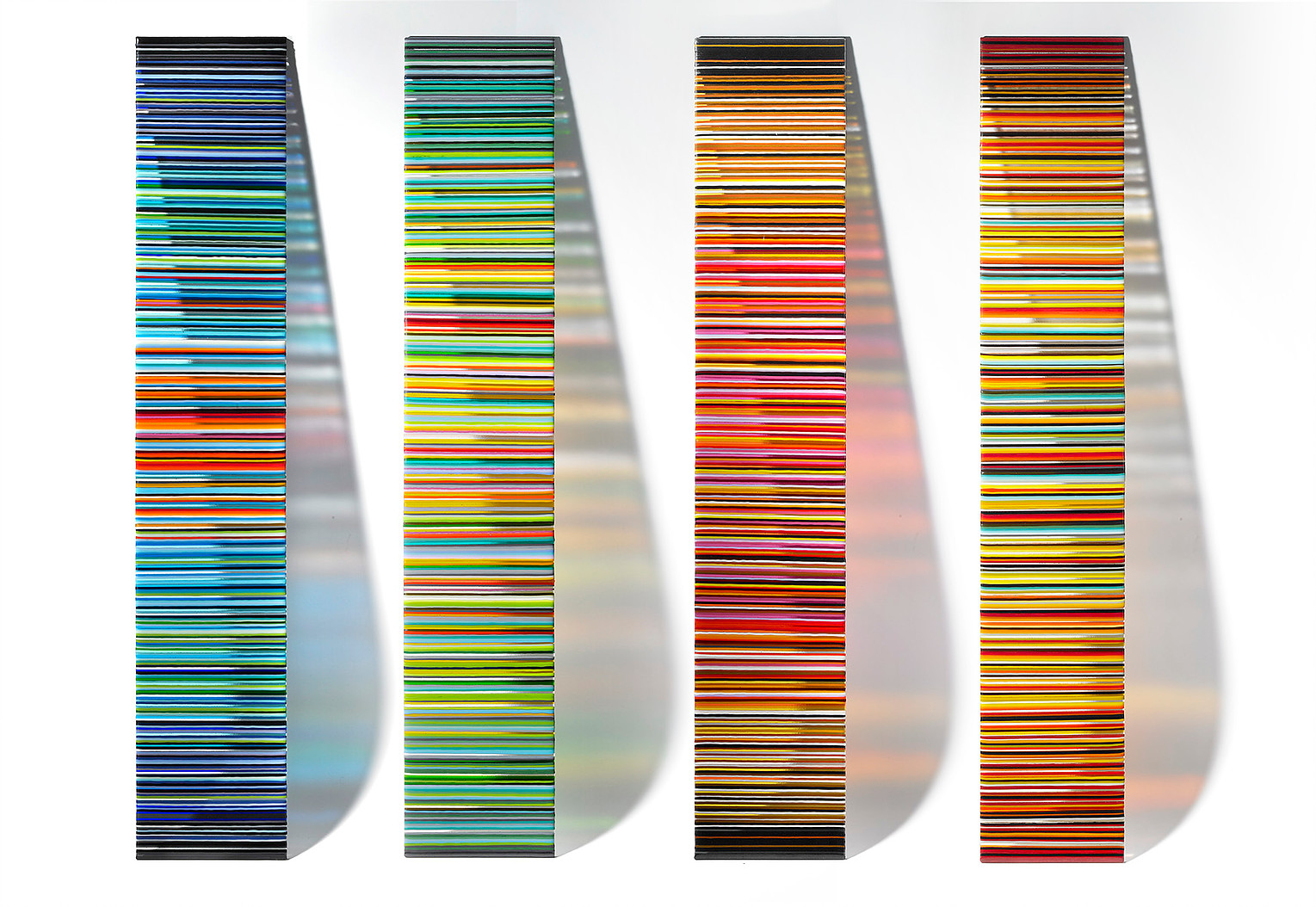 Looma Studios develops colorful custom glasswork in the form of vivid panels, tables, and more.