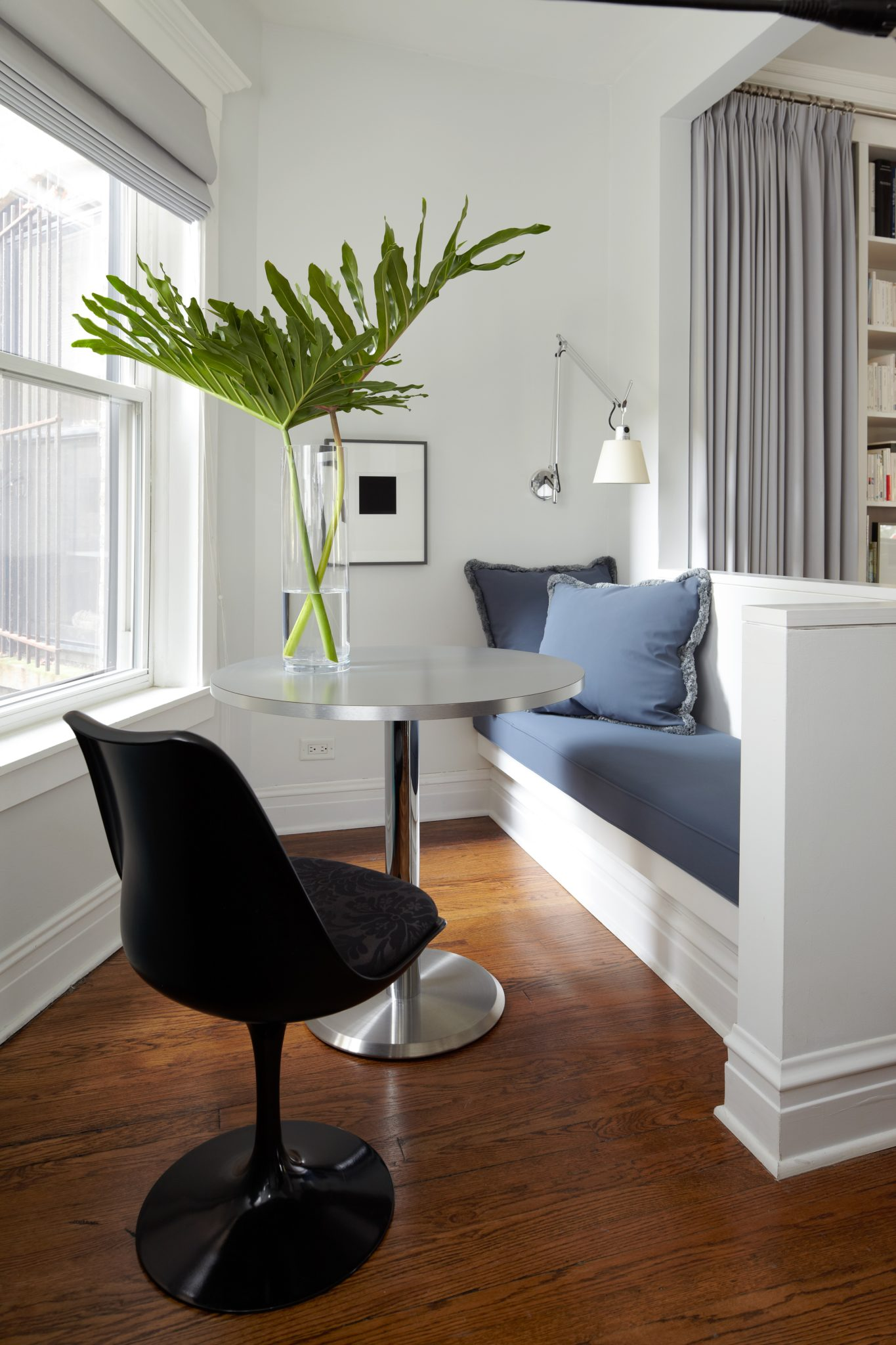 """Everything is designed at 36"""" high, including the art rail, the backs of the furniture, and the wall of the breakfast area, with the aim of creating a calming """"horizon"""" in the space."""