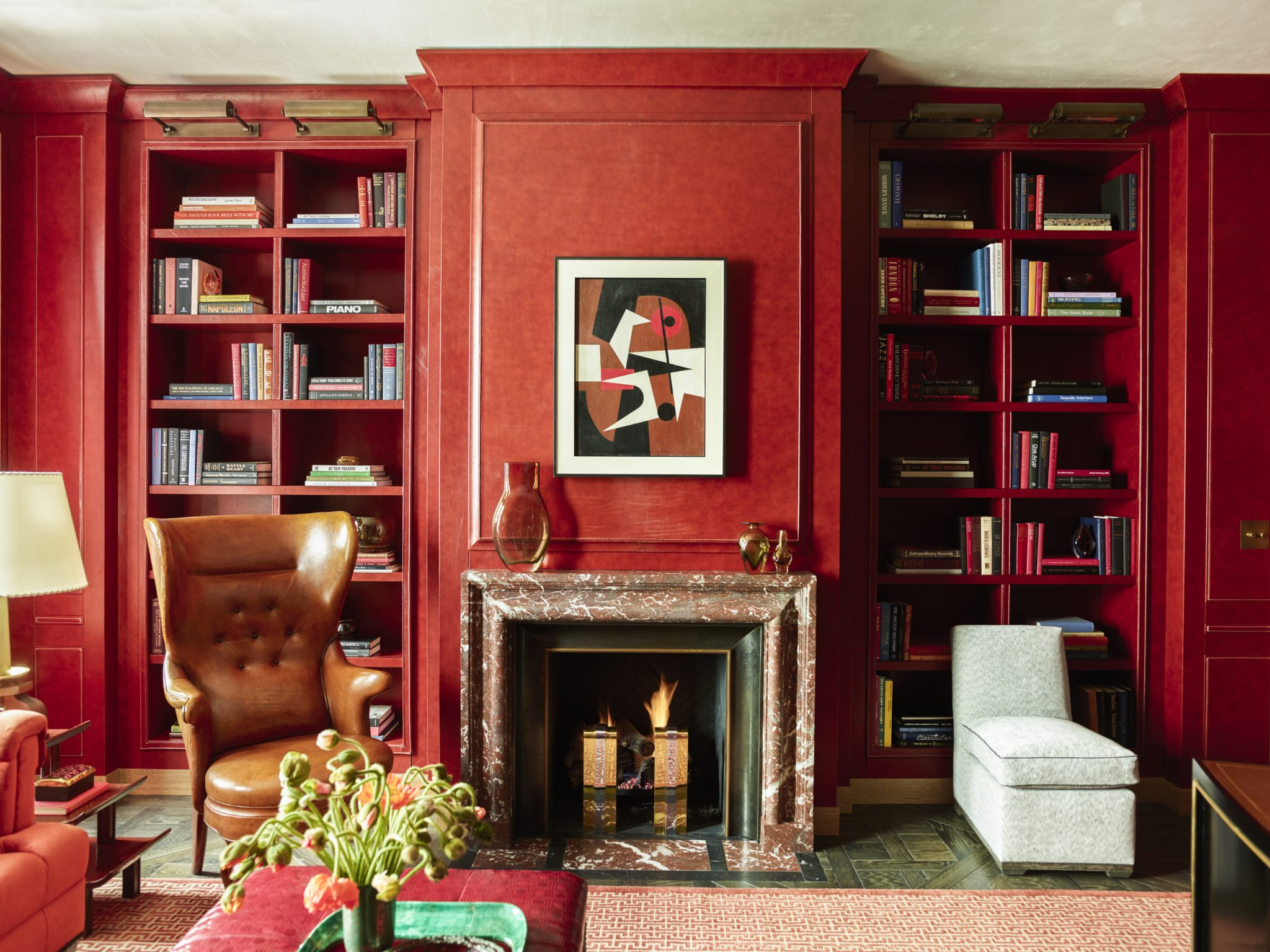 In an historically significant building in Chicago with spectacular views of Lake Michigan, Gambrel worked with theChicago-based firm Liederbach & Graham Architects; the designerlined the library insaddle-stitched red leatherin homage toFrances Elkins and David Adler whosefamous library for the 1927 Clow House in Lake Forest, Illinois, Gambrel considers one of the most beautiful rooms of the twentieth century.