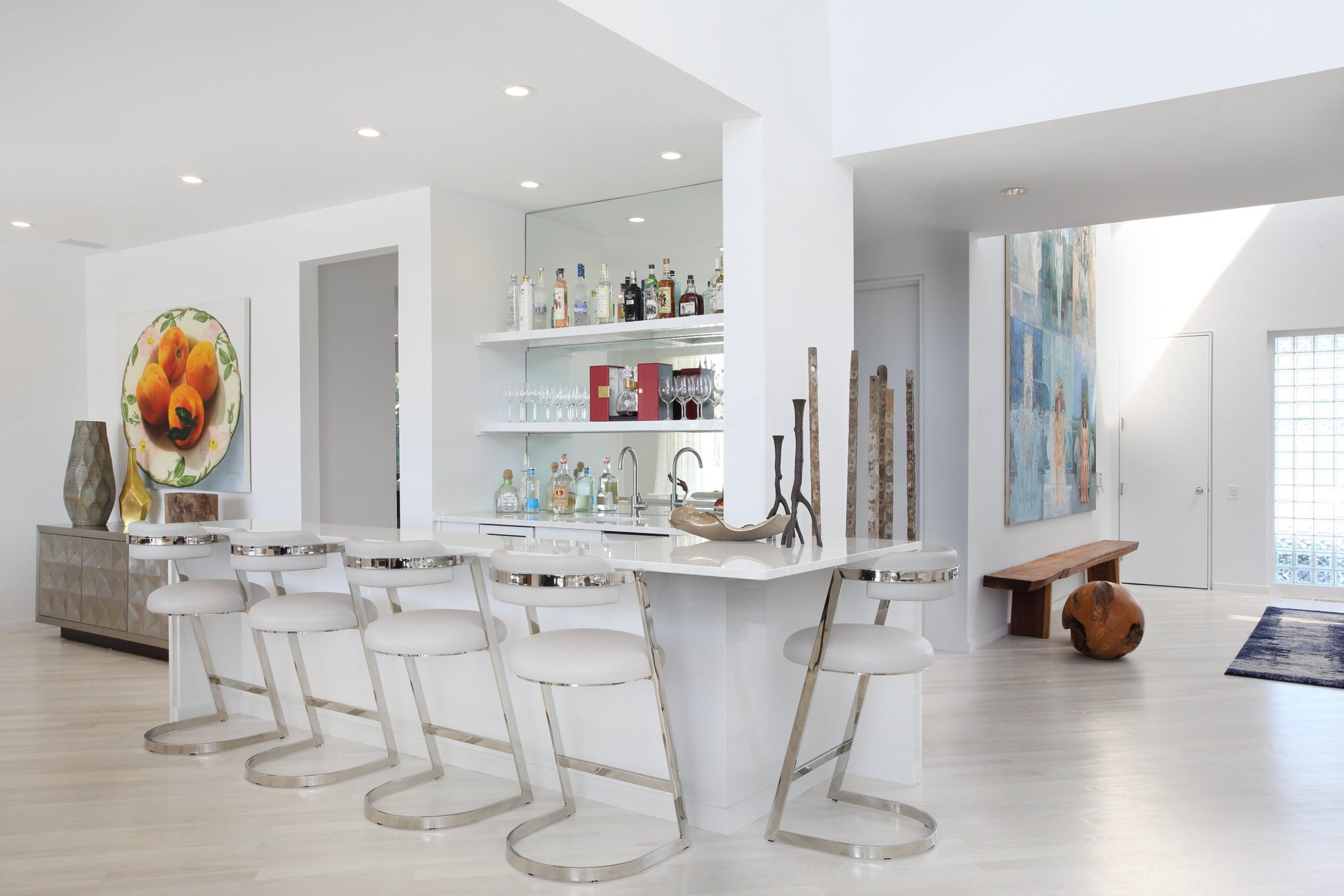 """Blend the Design with the Rest of the Home. """"Use materials that are appropriate to your color scheme and style, something that will enhance the rest of the room,"""" says Patricia Bonis. """"I like to include an accent material on the inset recessed panels — likea leather or fabric, mirror, or some type of stone, marble, or texture to enhance the surface.""""   The soft neutral color palettein this space was inspired by the home's surrounding views of the ocean and pool."""