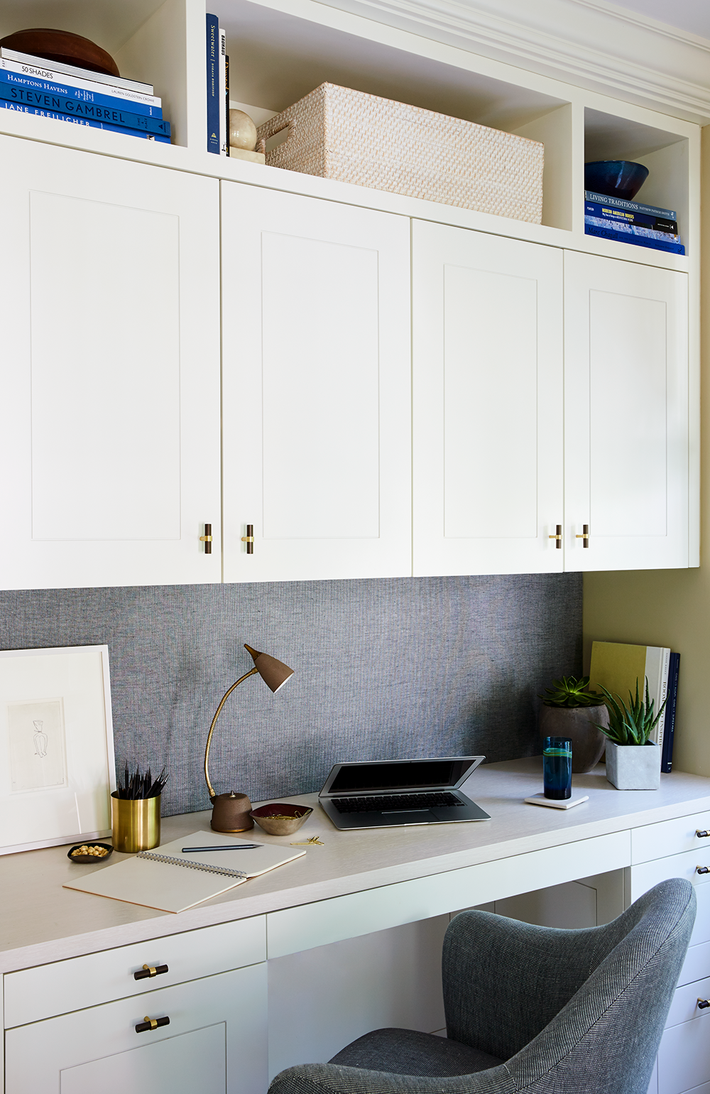 J. Patryce Design custom-designed the cabinetry for the office nook, pictured above.