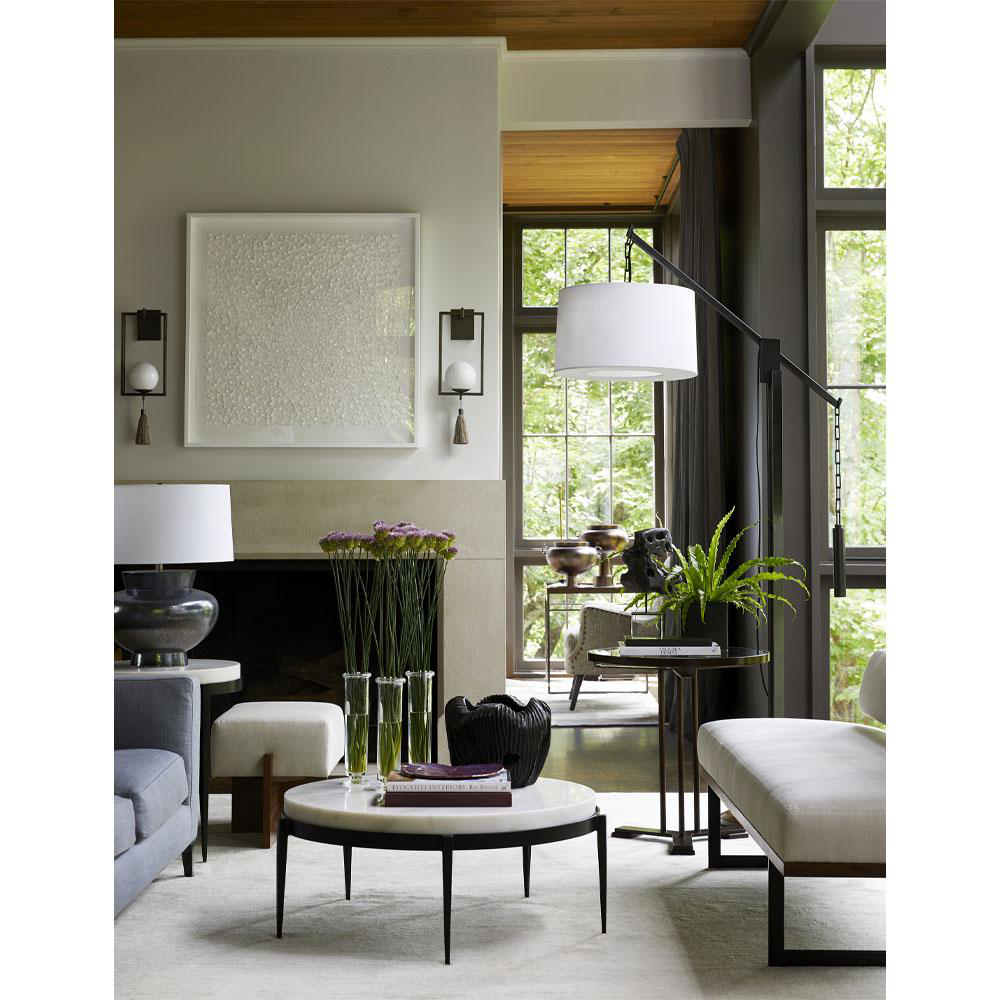Shot in Ray Booth's Nashville home, the images for this collection are styled with the utmost care. Here, the inventive sconces and floor lamp are particular standouts.