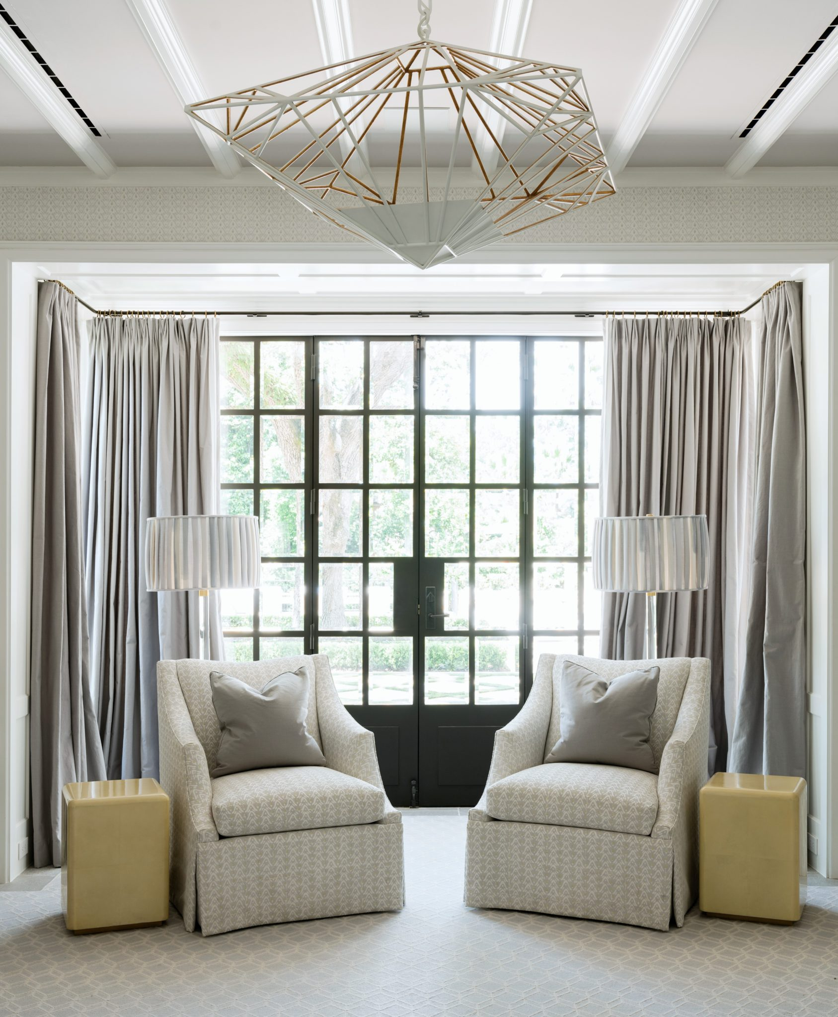 Ample light flows into the morning room's gridded doors, which were custom-created byRehme.