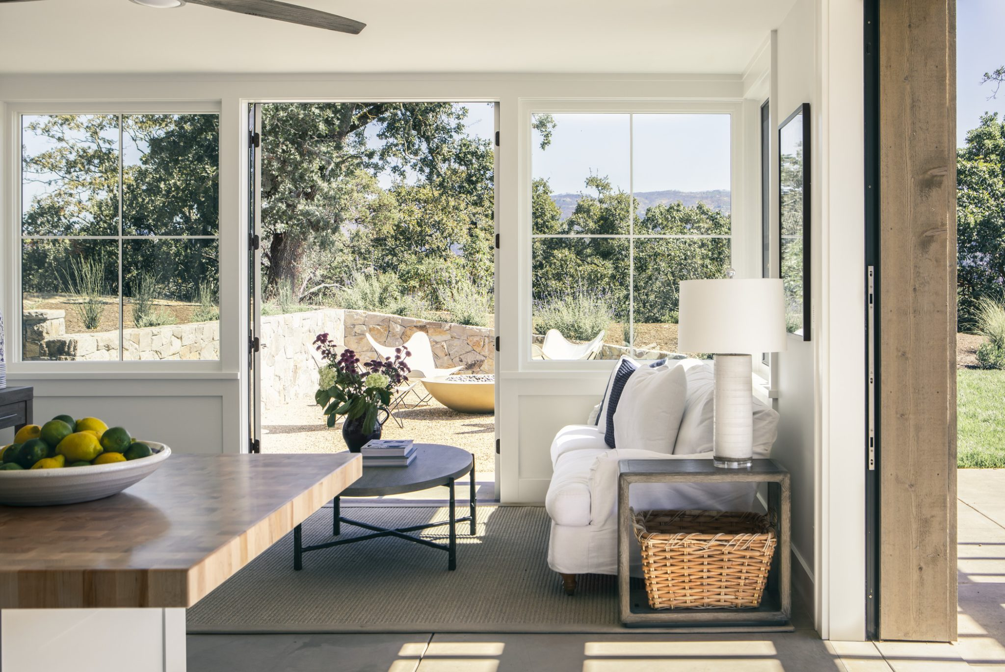 The poolhouse is more casual in personality, and it offers plenty of space for guests.