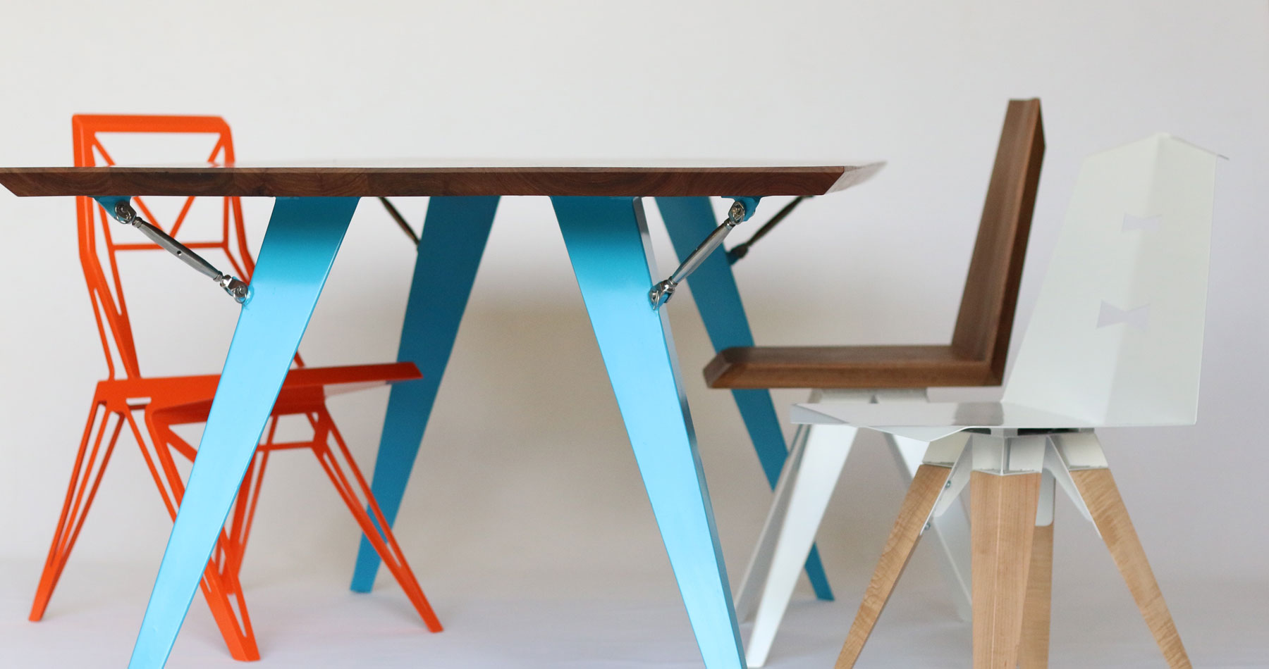 Bayly Art creates modern furnishings for both indoorand exterior use, including chairs, tables, and stools.