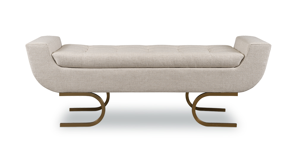 The Encanto Bench was inspired by 1970s glam, with elongated lines and sleek inverted horseshoe brass legs. The soft button tufted pad top seat is removable.