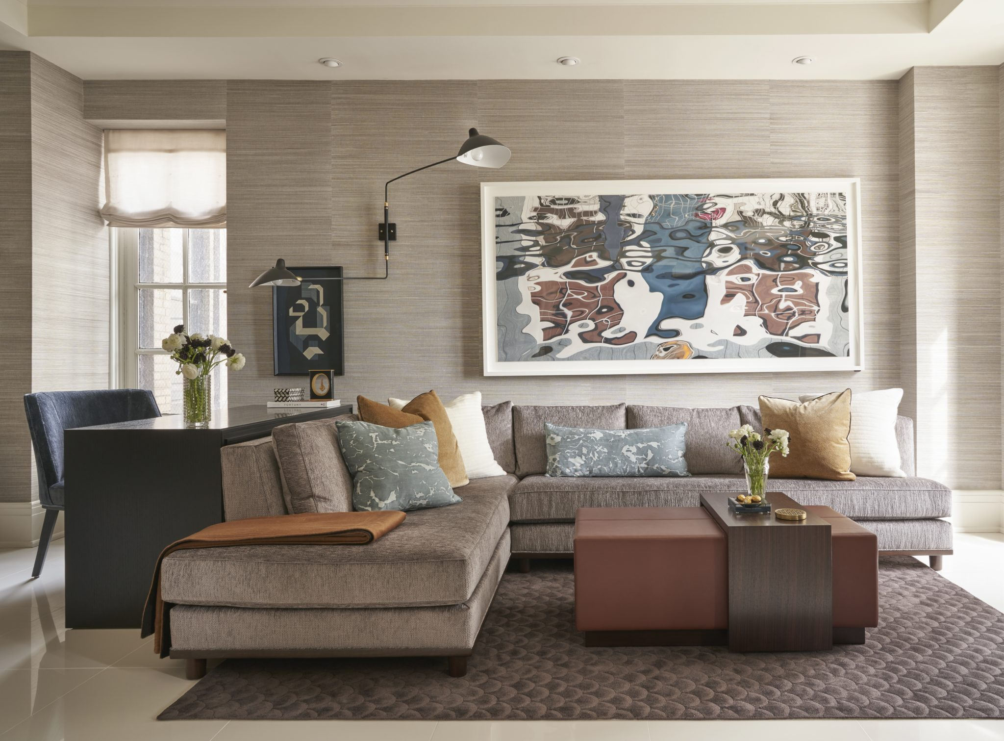 Q: How did you select the colors and textures for the living room?  A: We kept the large pieces in the room neutral and let the artwork dictate the splashes of color that are echoed in the decorative pillows.