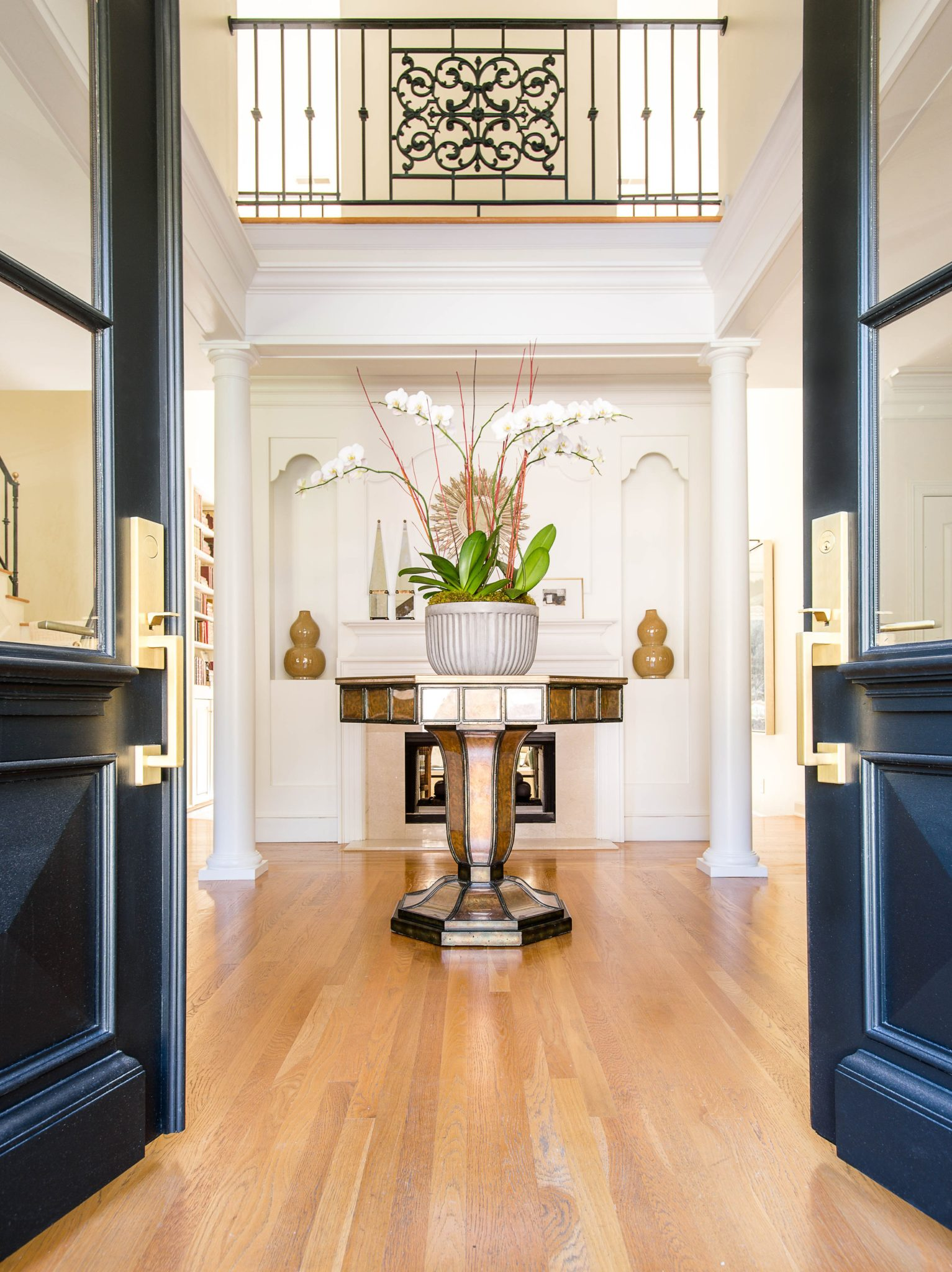 """11. Dark-Colored Doors    From deep blues and greens to solid black, a dark-painted door adds drama to any space. """"Dark-colored doors work with many architectural styles,"""" saysJonathanSavage ofSAVAGE Interior Design.""""This style will continue in 2020 as it's a great way to emphasize a front entrance. A dark-colored door adds impact and dimension to a foyer or entryway.""""  Here, Savage uses adeep green door, which he says """"grounds the home while being welcoming and inviting at the same time. It adds richness and depth to a small intimate space."""""""