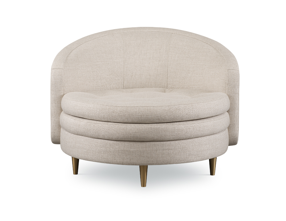 The oversized Florence Chaise was inspired by the design of the Guggenheim, and features a stacked pancake seat, brass legs, and a coordinating ottoman if desired.