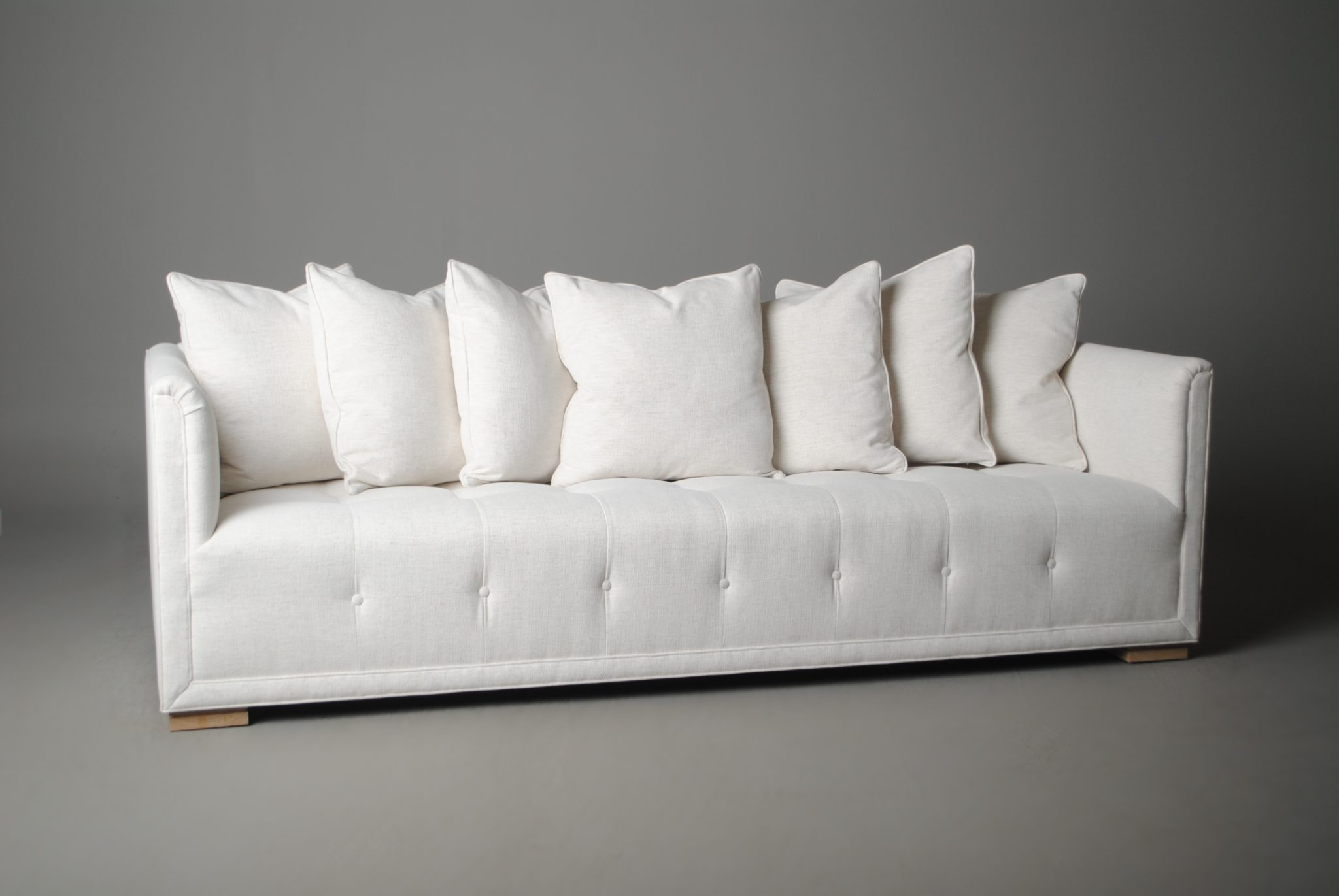 Also by Laslo, the Network Sofa has a tufted seat and back that almost emulates a netted pattern.