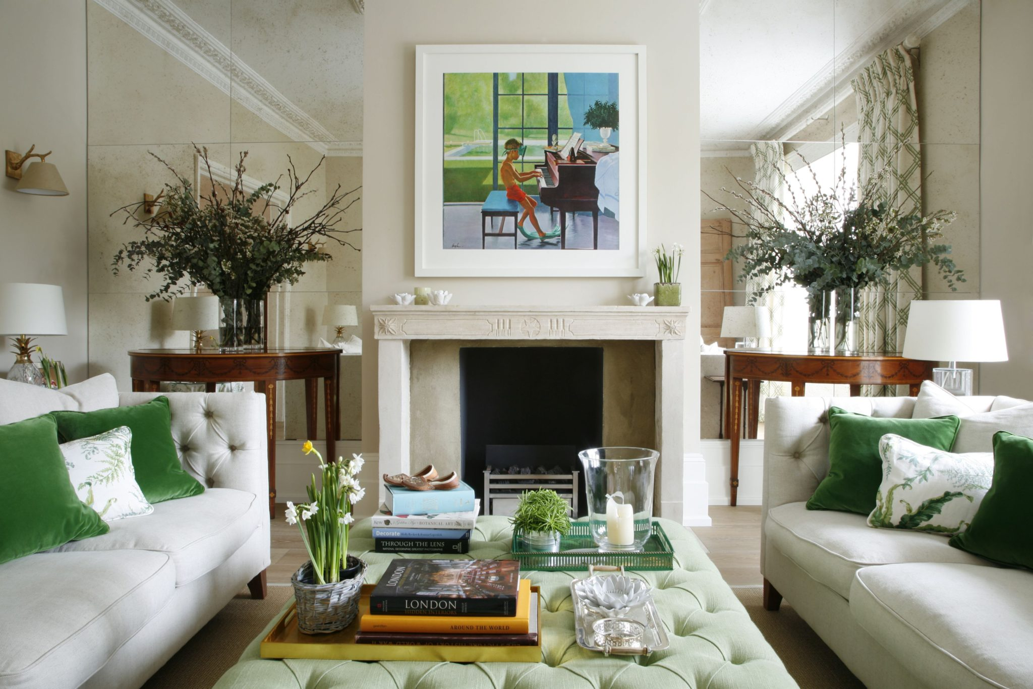 London living room with antique mirror wall and custom made coffee table by VSP Interiors