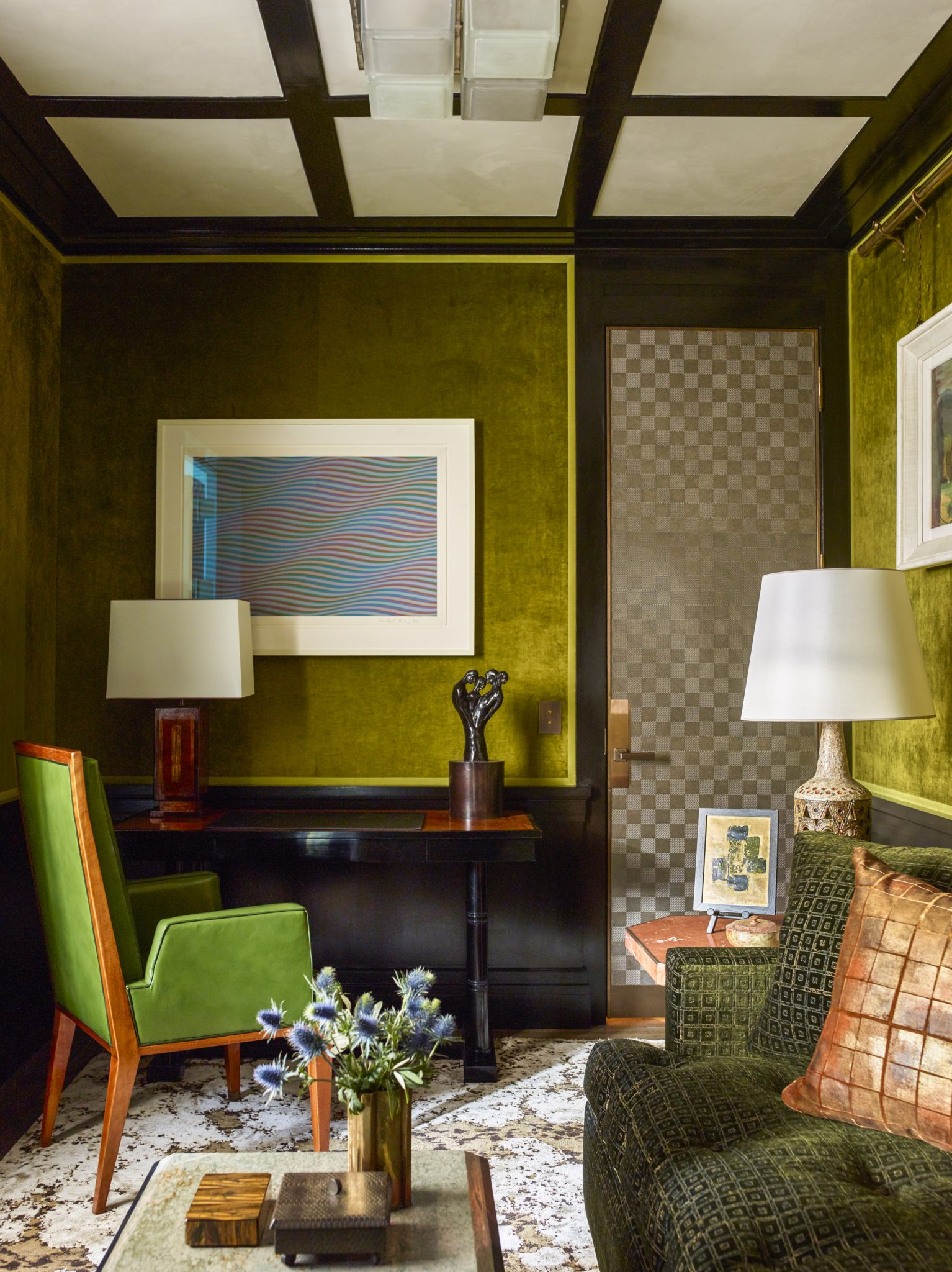 """For apied-à-terre in London's Mayfair neighborhood, Gambrel made certain thatnearly every surface hadpatina, texture, and what he terms, """"rugged polish."""" Thewalls in this small alcove roomare upholstered in mossy green velvet."""
