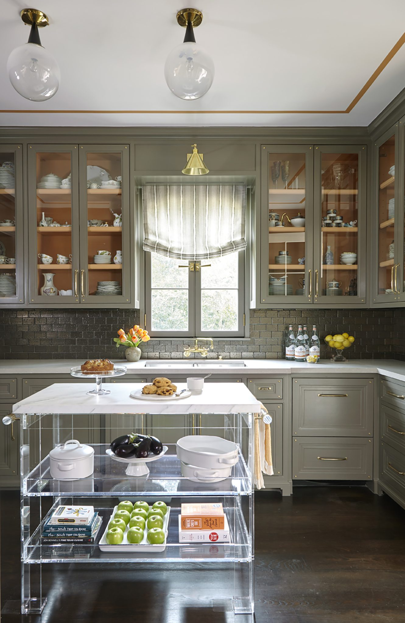 The butler's pantry relies on contemporary accents to updatea classic, French provincial look.