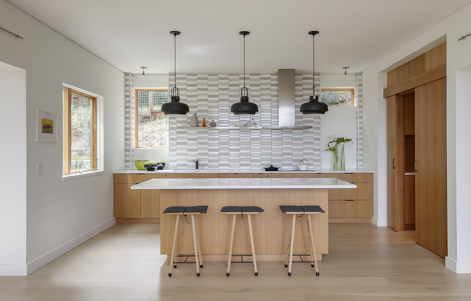 All the kitchen appliances are by GE Monogram. The pendant lights are Copenhagen SC6 pendants, a piece developed by Space Copenhagen for &tradition.