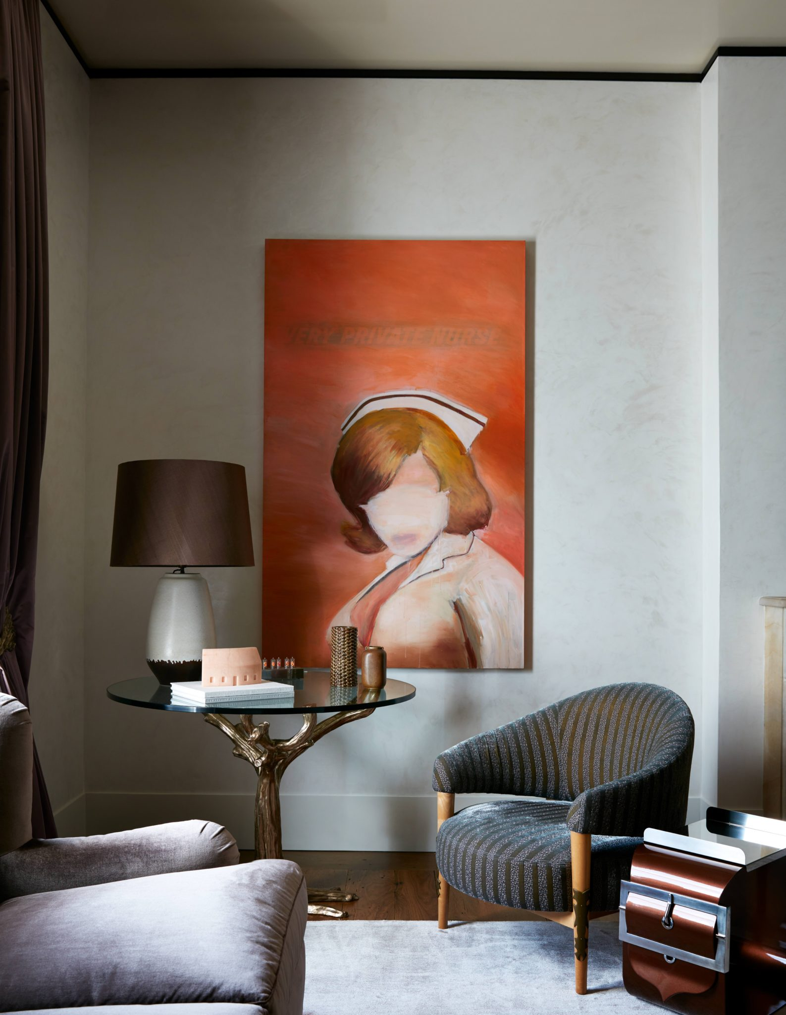 In a corner of the master bedroom in a reconfigured Upper East Side duplex, a Garouste & Bonetti Concerto armchair is joined by a Maria Pergay bracelet side table and a 2007 Richard Prince painting, Very Private Nurse #1.