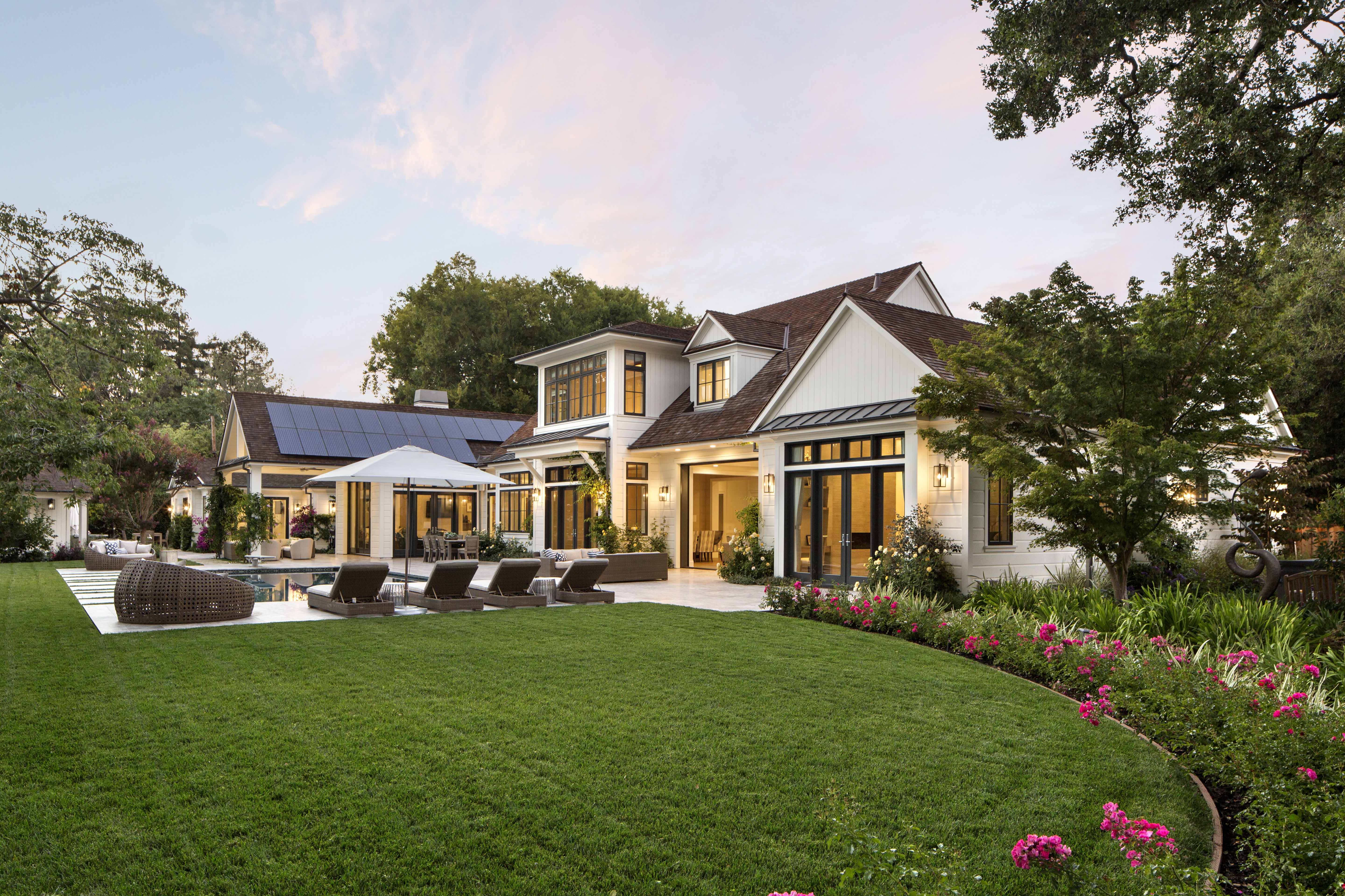 """This Silicon Valley home has beautiful landscaping and various outdoor living areas ideal for the entire family. """"The park-like setting feels like it could be one hundred miles from where computers were invented,"""" says Sullivan of the home's backyard."""