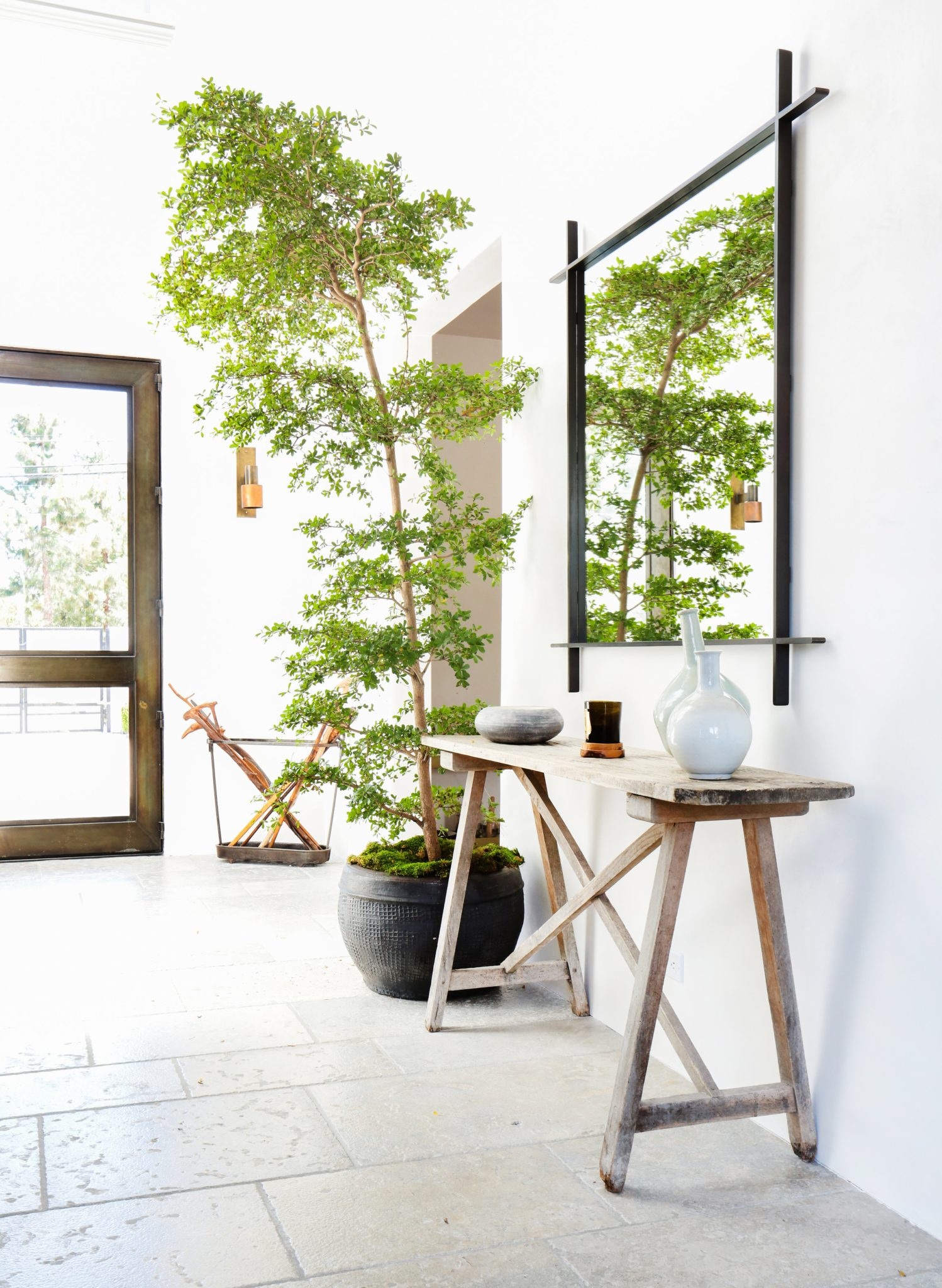 Grayfox: Greenery Makes a Bold Statement in a Cool-Toned Entryway by Alexander Design