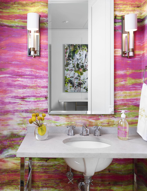 The colorful powder room of an Austin pied-a-terre, designed by Greer Interior Design.
