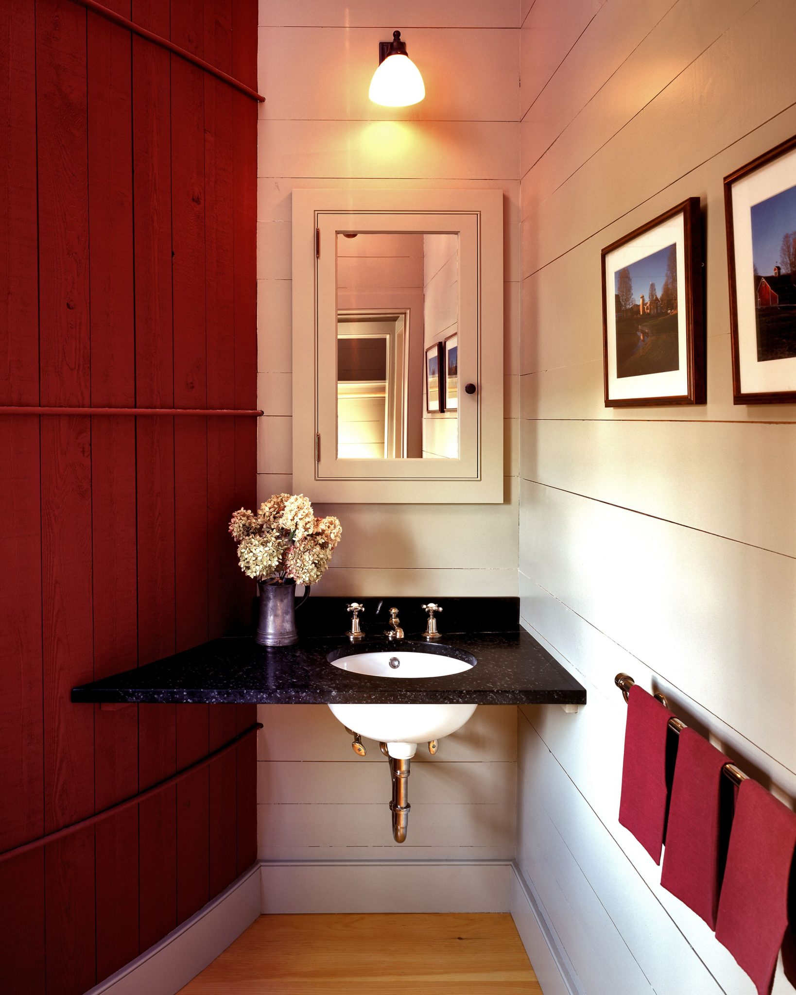 A chic, rustic-style red bath by Haver & Skolnick Architects.