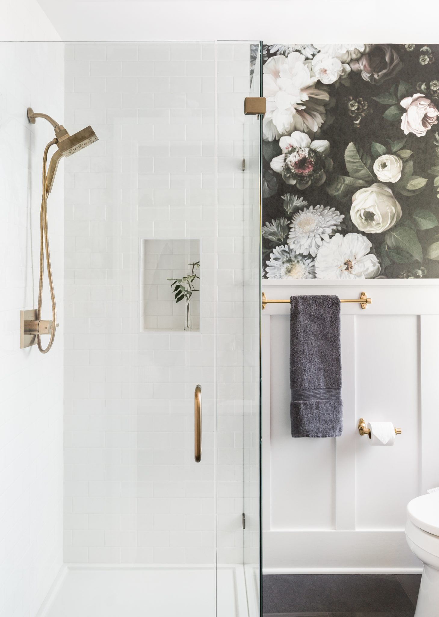 Within the shower, the hardware is from Delta Faucet; all other brass hardware in the bath is from Rejuvenation.