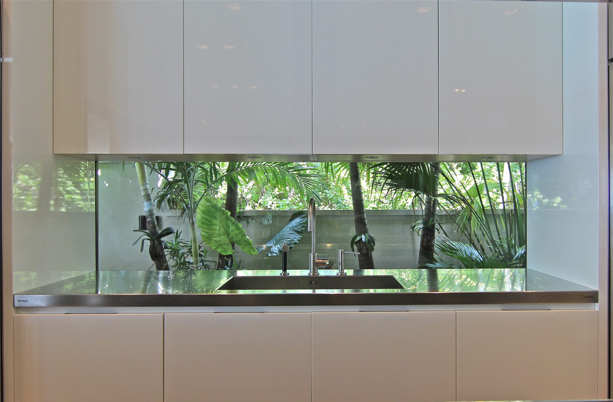 Bringing nature in with a window back splash. by Chelsea Design