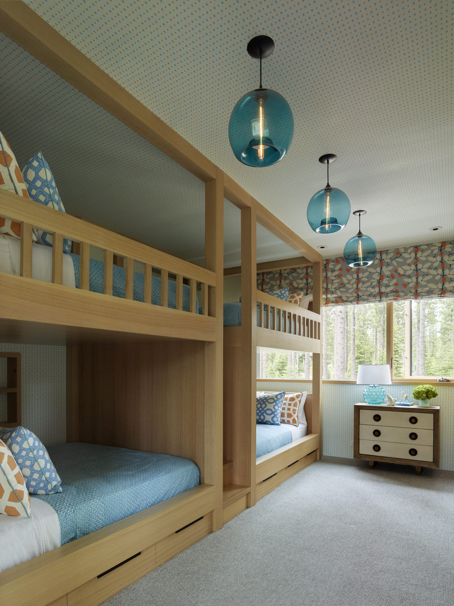 In the children's room, theoak bunk beds are a customdesign, the pendant lights are by Niche Modern, the chest of drawers is by Studio A, and the carpetis by Floordesign, Inc.