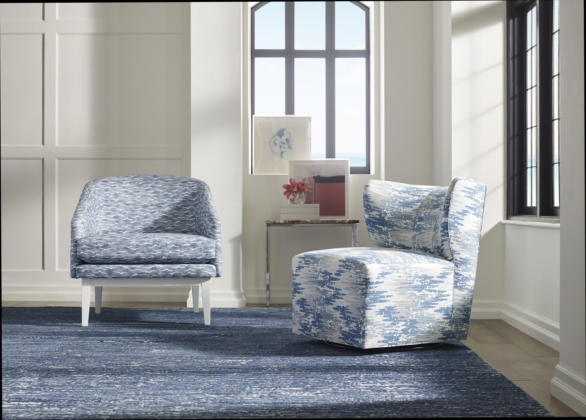 In this sitting area scene, the left side chair is the Hanover chair in Angelus in Pacific, while the chair to the right is the Sedgewick Slipper Chair in Whitecap in River. The side table is again the Arvada side table. The rug is Slant in Surfside.