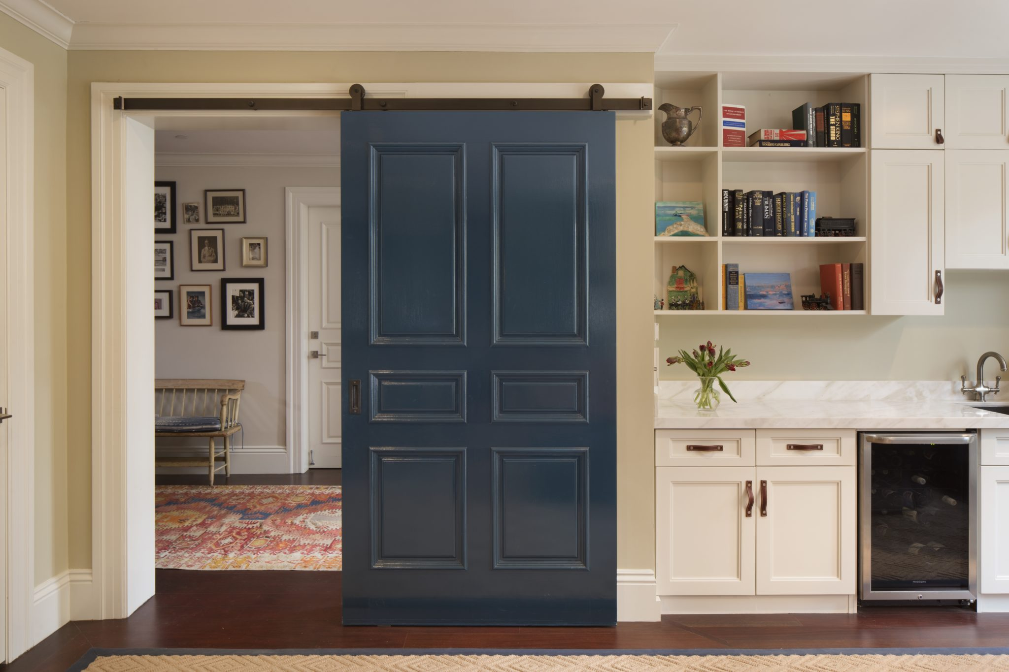 Family Room with Blue Barn Door and Mini Bar by Jeff King & Company