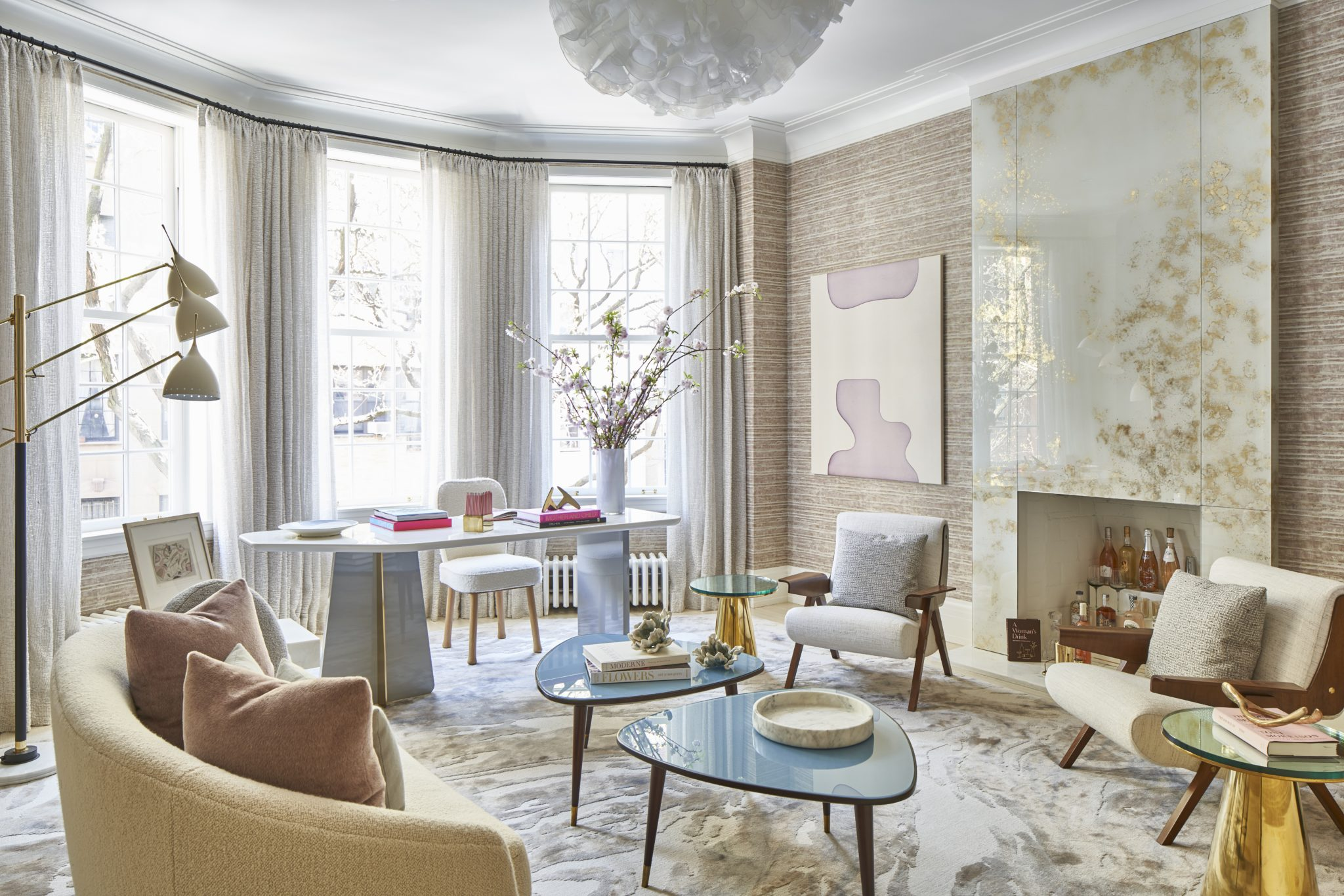 Focusing on femininity,Eve Robinson Associatesdesigned a room perfect for a woman's various roles and includes areas for work, entertaining, and private reflection.