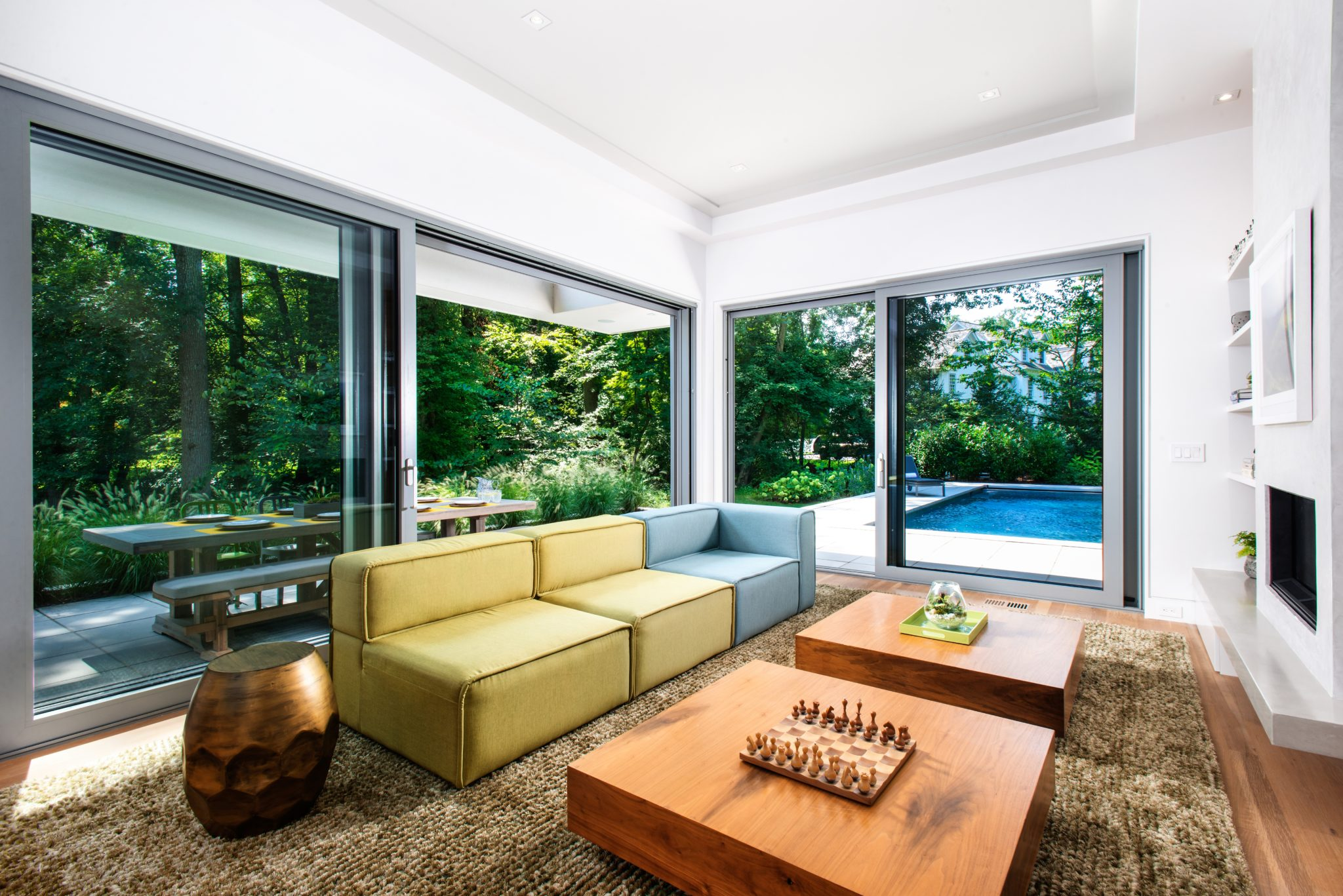 Family Room with Expansive Sliding Doors to Outside by Vita Design Group