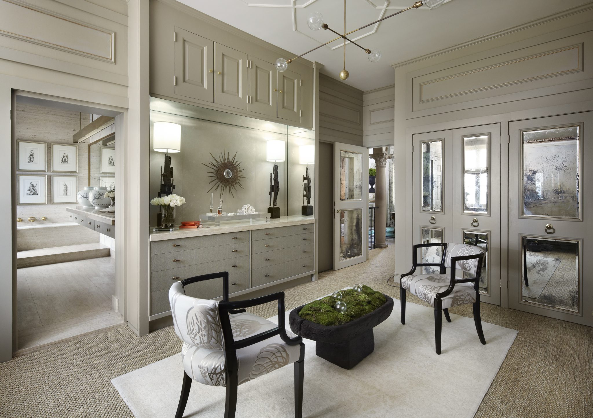 """""""A room that is incomplete lacks the layering process. There is a misconception with homeowners — they think that filling a room with furniture completes the room,and that is the farthest from the truth in my opinion."""" —Randy Heller Inc. / Pure & Simple Interior Design,Highland Park, IL  Favorite Finishing Touches: """"The last pieces that I add to a room would be art and accessories.In this room, and all rooms that I design, when considering the finishing touches, I always strive to come up with ideas that will create an unexpected pleasure upon entering the room for the first time.I always consider or think about bringing in visual as well as tactile textures.In this room the finishing textures would be the rough yet warm sisal wall-to-wall rug, the dark, moody, vintagebrutalist lamps made from black-dipped steel, the polished yet aged blackened mirrors, the applied moldings I added to the ceiling to create formality, and the freshly picked green moss for itsfragrance, color, and natural texturerepresenting the outdoors.""""  Design Advice:""""For homeowners looking to just freshen their space, I would suggest adding fresh flowers. It's hard to mess that up and does not require a professional designer!If a DIYwants to be a bit more daring, I would suggest wallpaper or paint."""""""