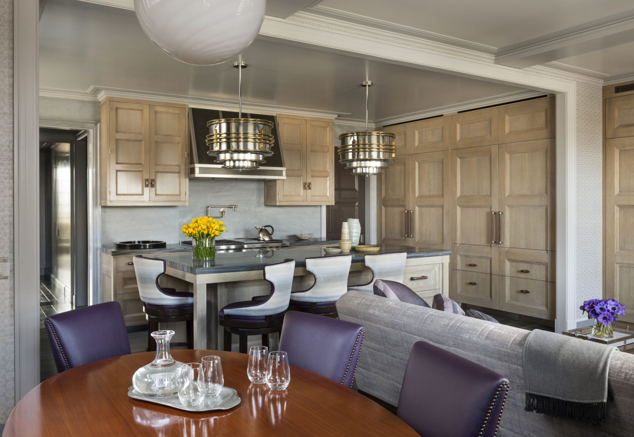 A large kitchen and family room replaces several smaller maid's rooms and pantries.