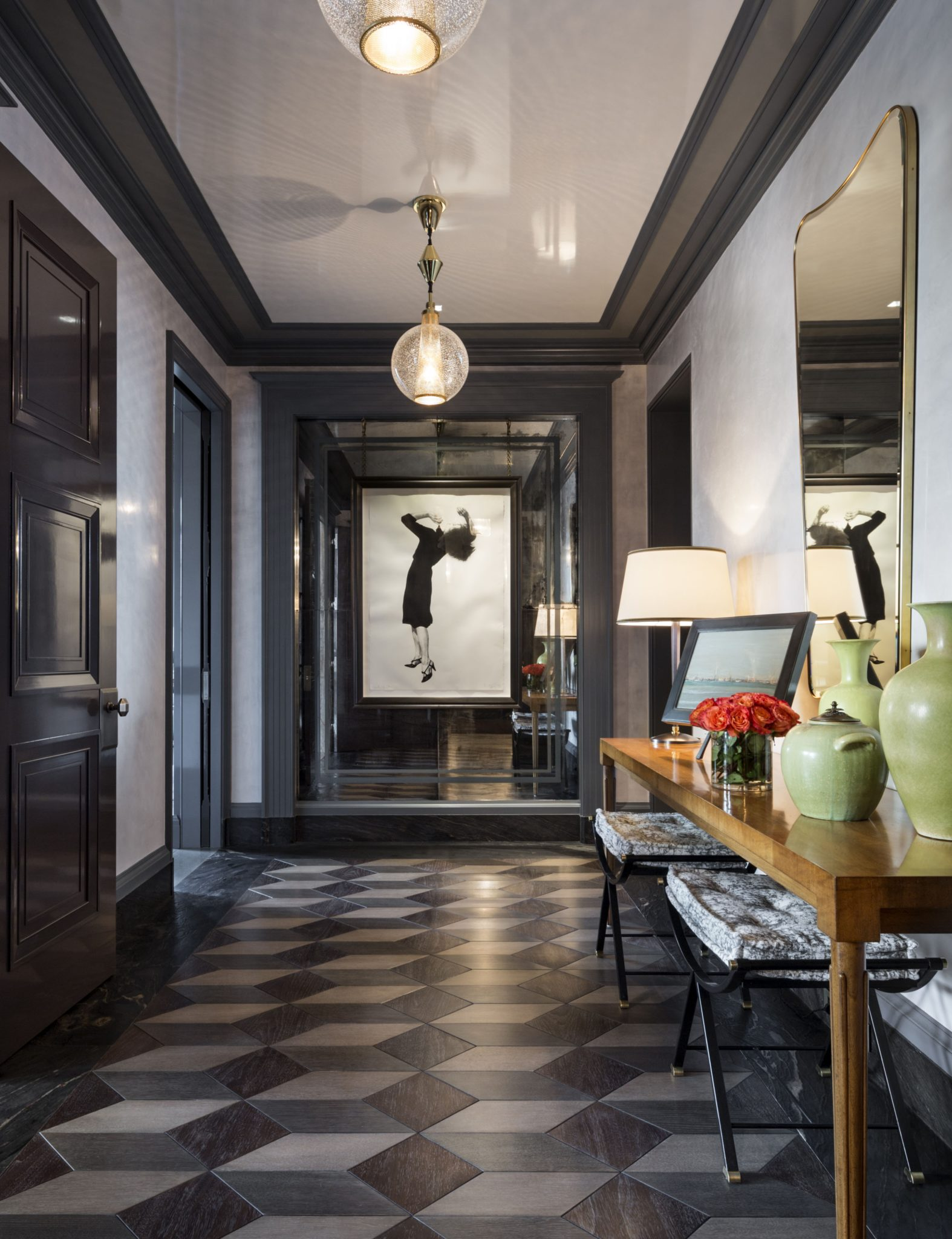 Gary Brewer, a partner at Robert A.M. Stern Architects, and Steven Gambrel of S.R. Gambrel, Inc., collaborated on the renovation of a stunning Manhattan penthouse. Therefreshed entry hall, featuring new graphic marquetry and new casings and trim, opens to the living room, dining room, and library.