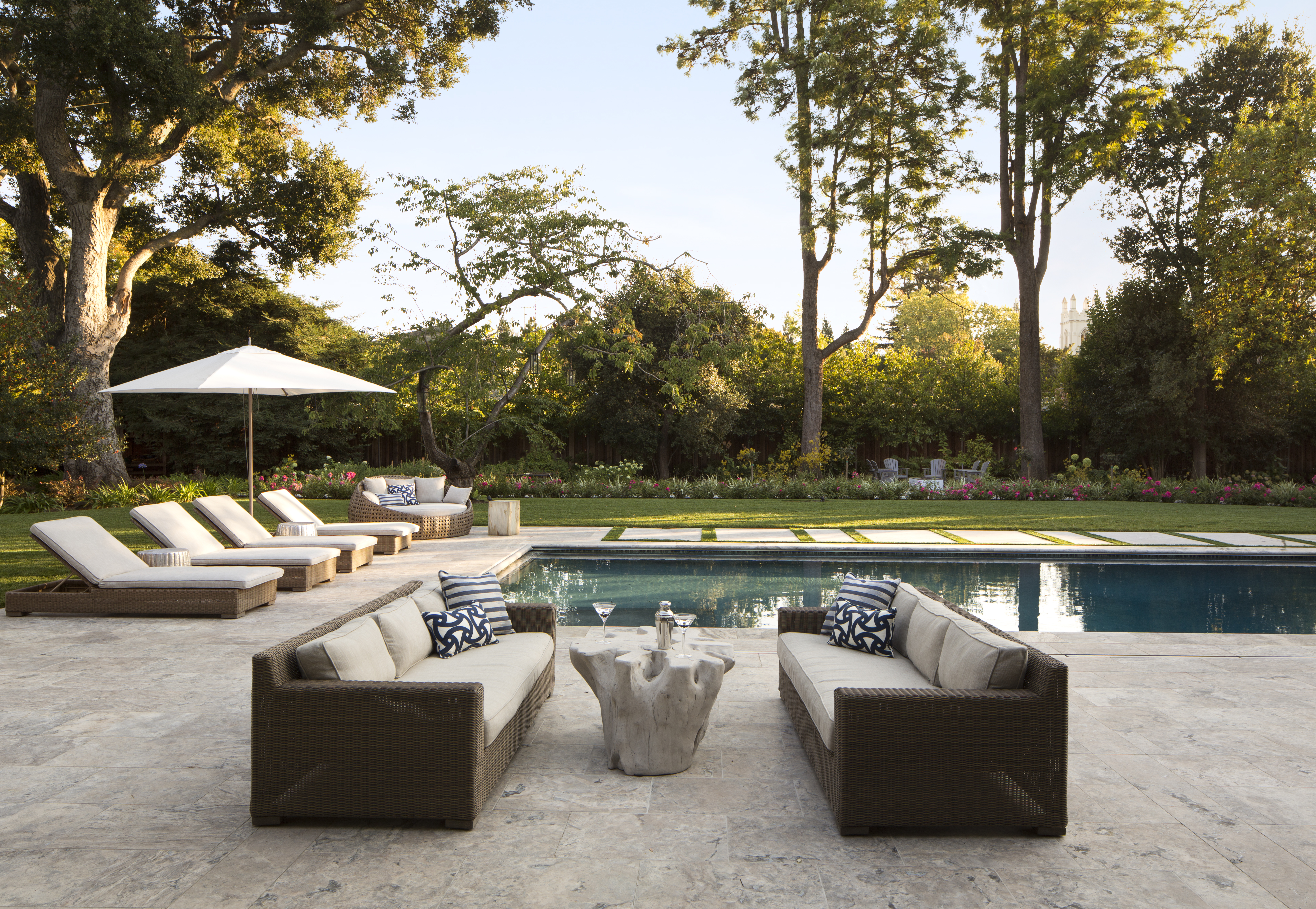 While outside, you can lounge in one of many seating areas — whether you prefer the cream sofas, the lounge chairs, orthe cozy daybed.