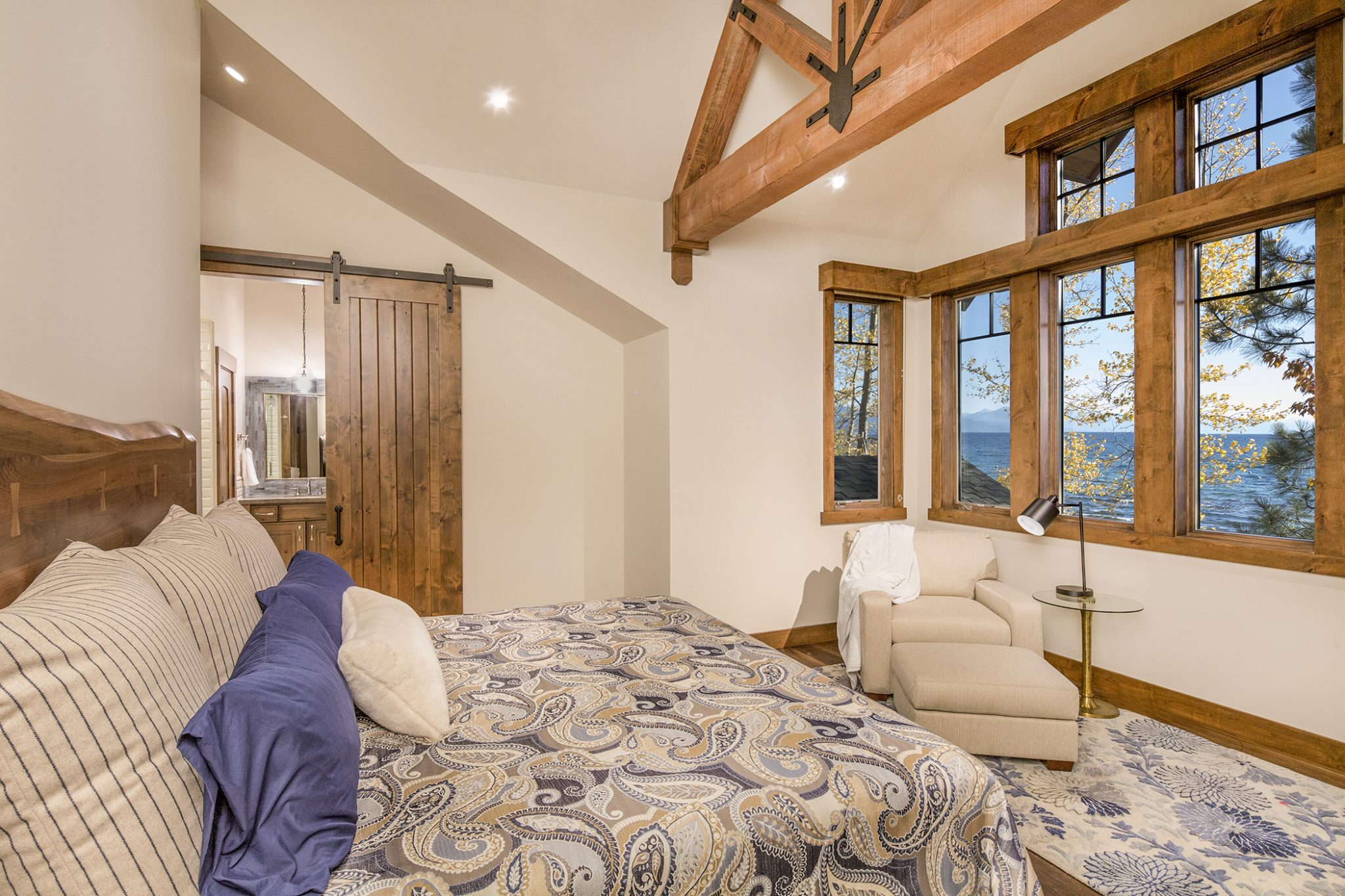 Brockway on the Lake, Lake Tahoe, paisley duvet, barn door and exposed beams by Aspen Leaf Interiors, Inc.