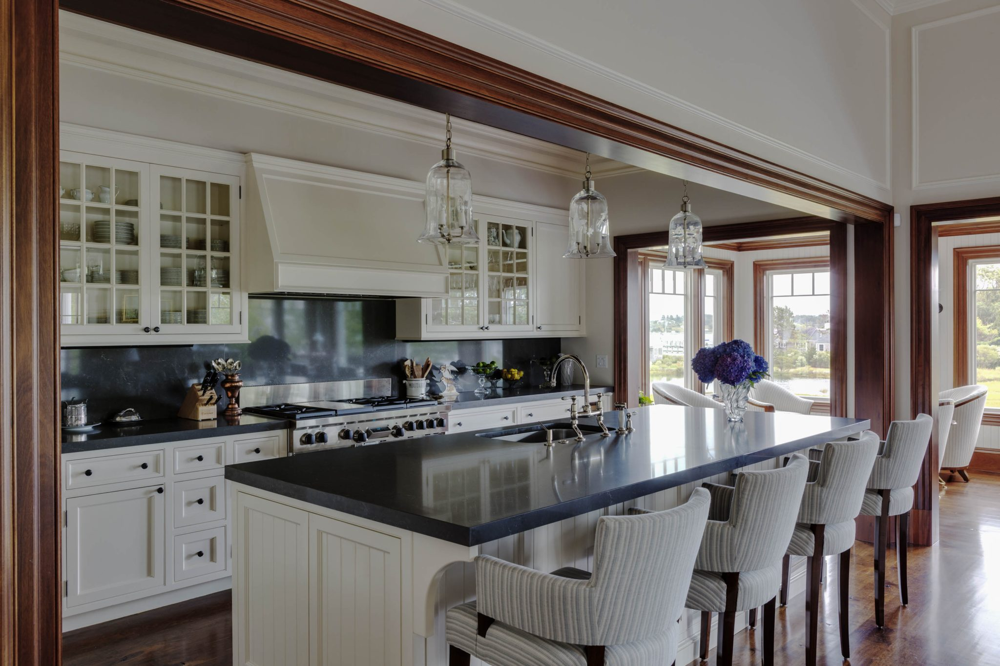 A welcoming, open wood-beamed kitchen by Patrick Ahearn Architect