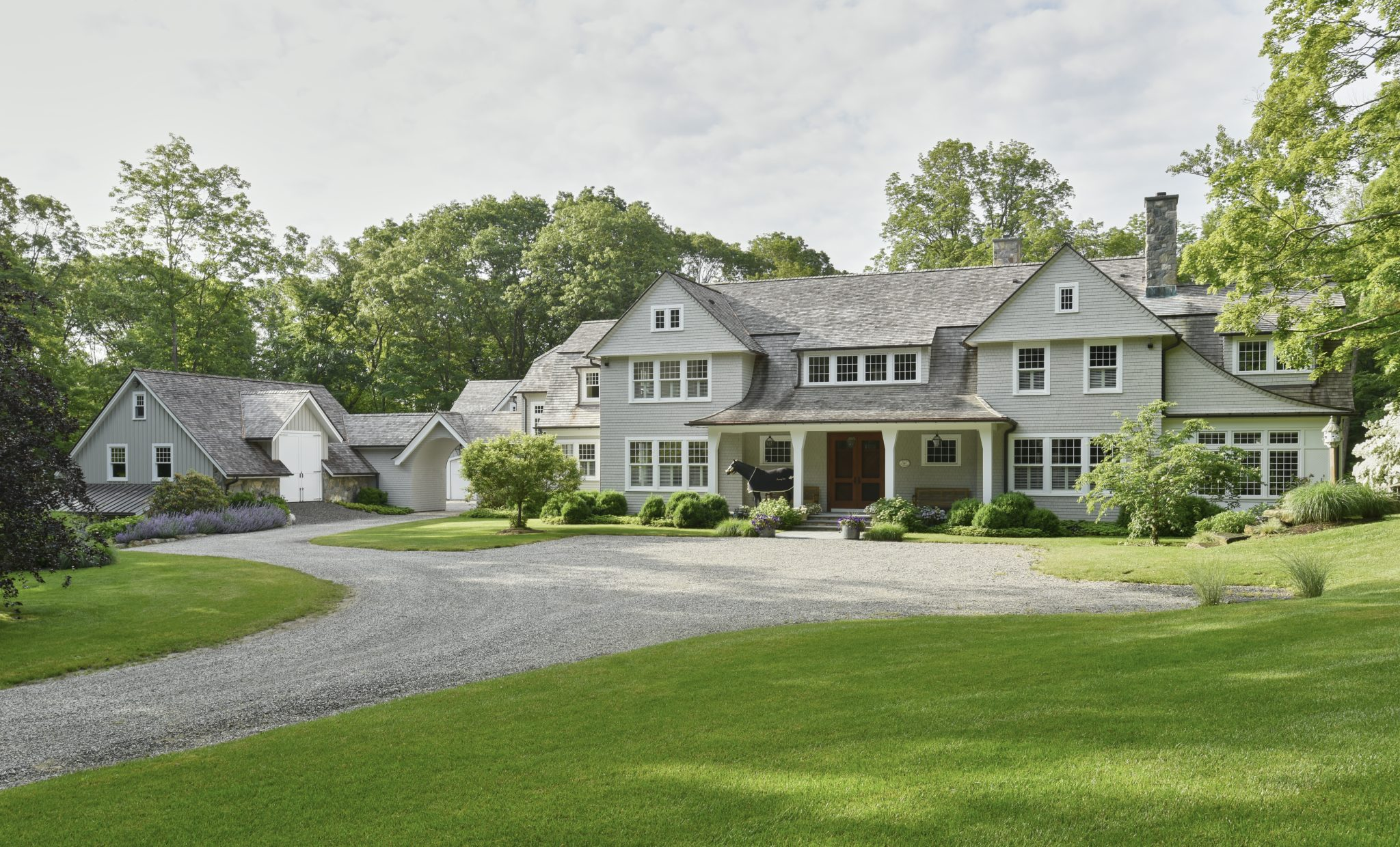Shingle style home with carriage house and porte cochere by Huestis Tucker Architects, LLC