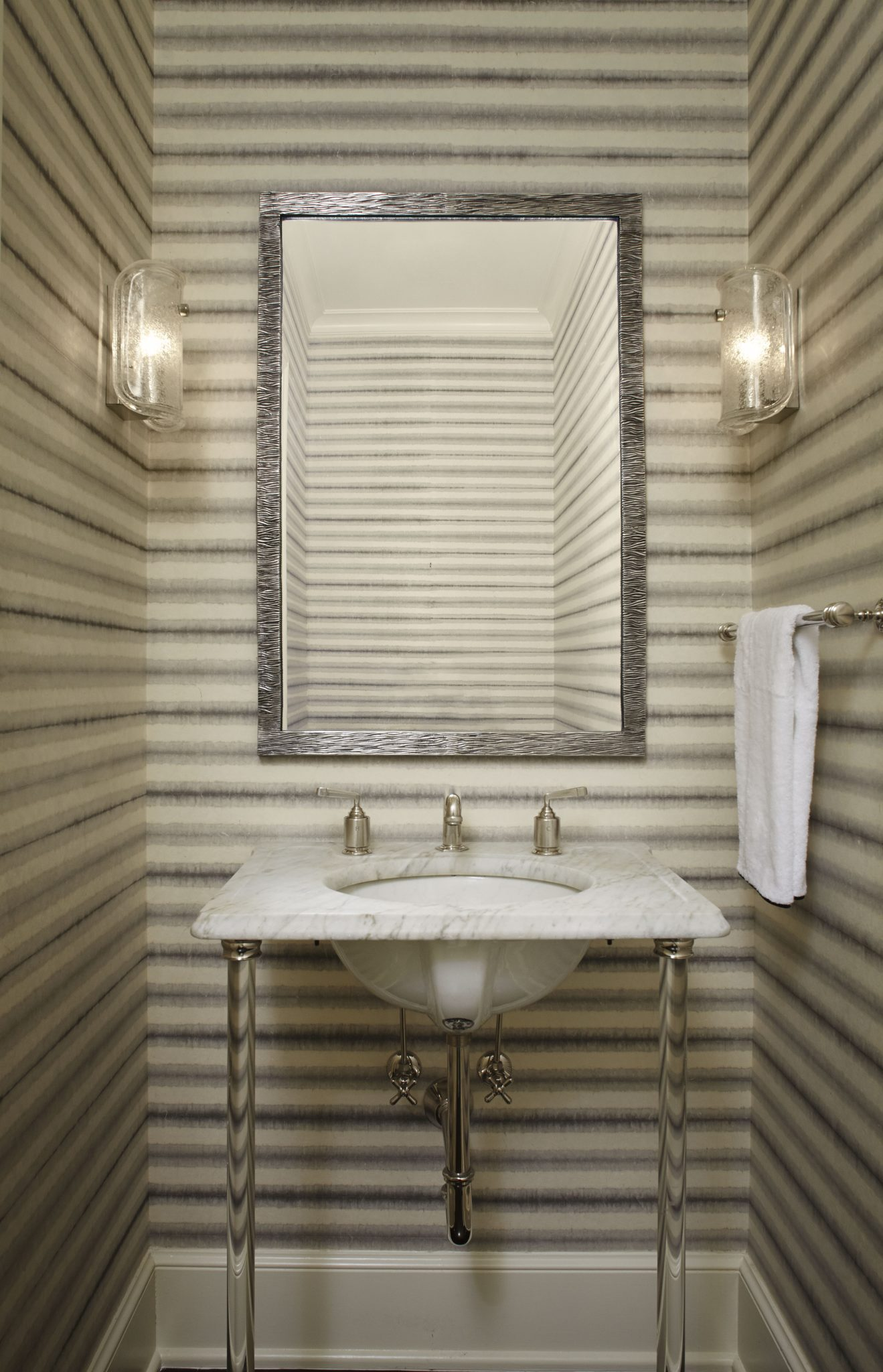 Stylish stripes in the powder room of a townhouse in Lincoln Park, Chicago, byLichten Craig.